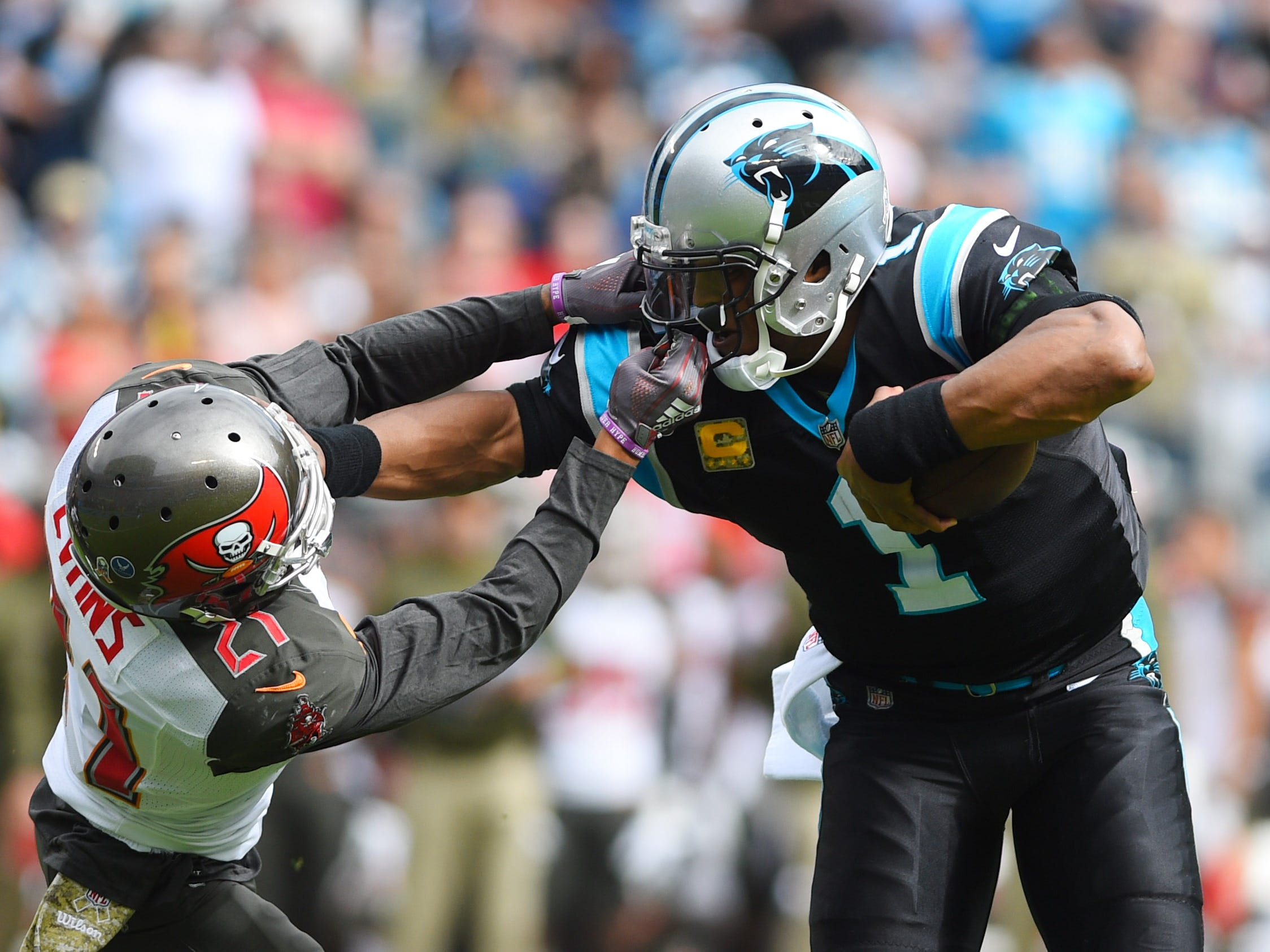 Week 9: Carolina Panthers quarterback Cam Newton runs with the ball as Tampa Bay Buccaneers strong safety Justin Evans defends in the first quarter at Bank of America Stadium. The Panthers won the game, 42-28.