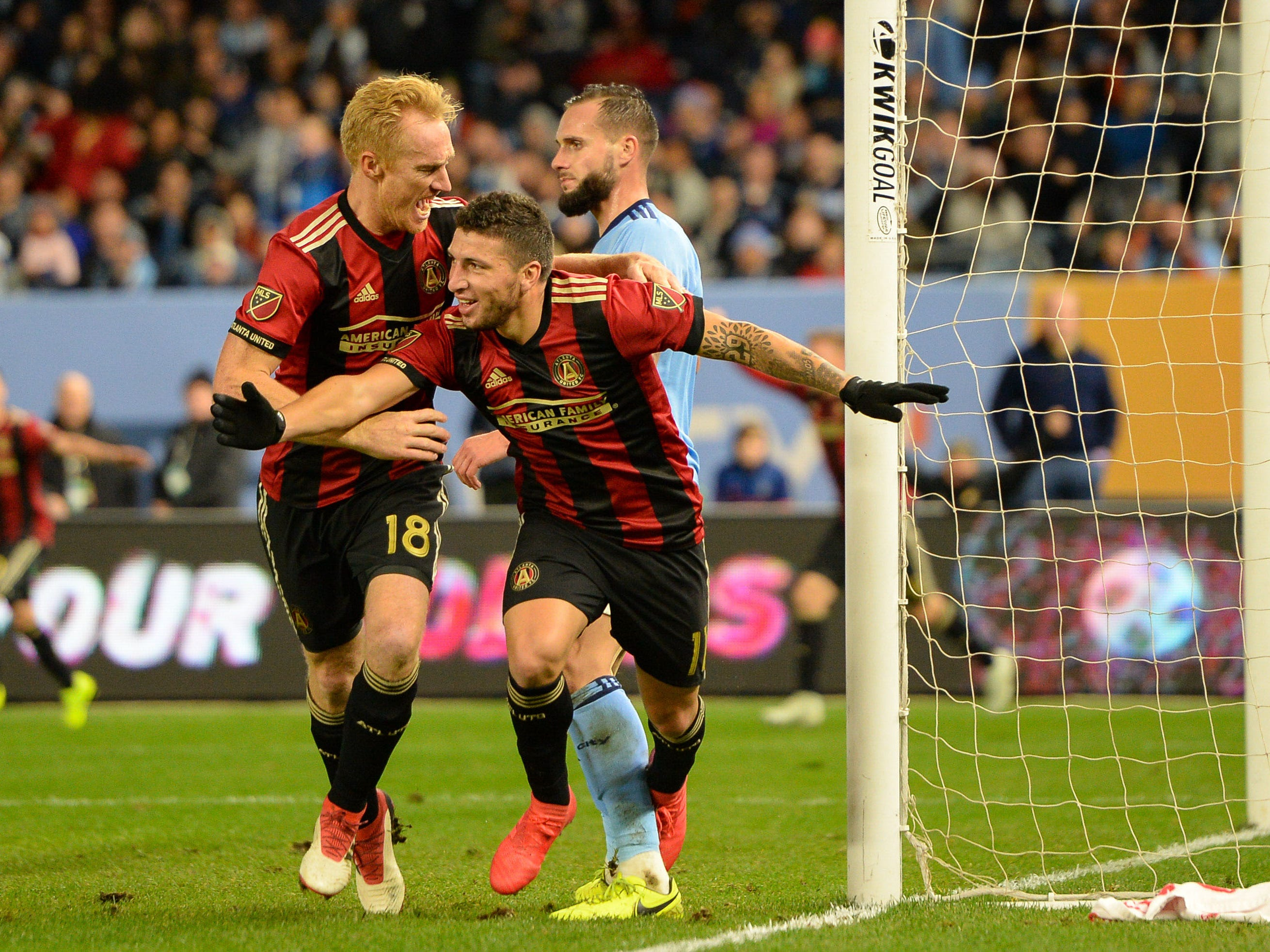 Atlanta United midfielder Eric Remedi (11) celebrates his goal with teammate Jeff Larentowicz (18) against New York City FC  during the first half at Yankee Stadium.