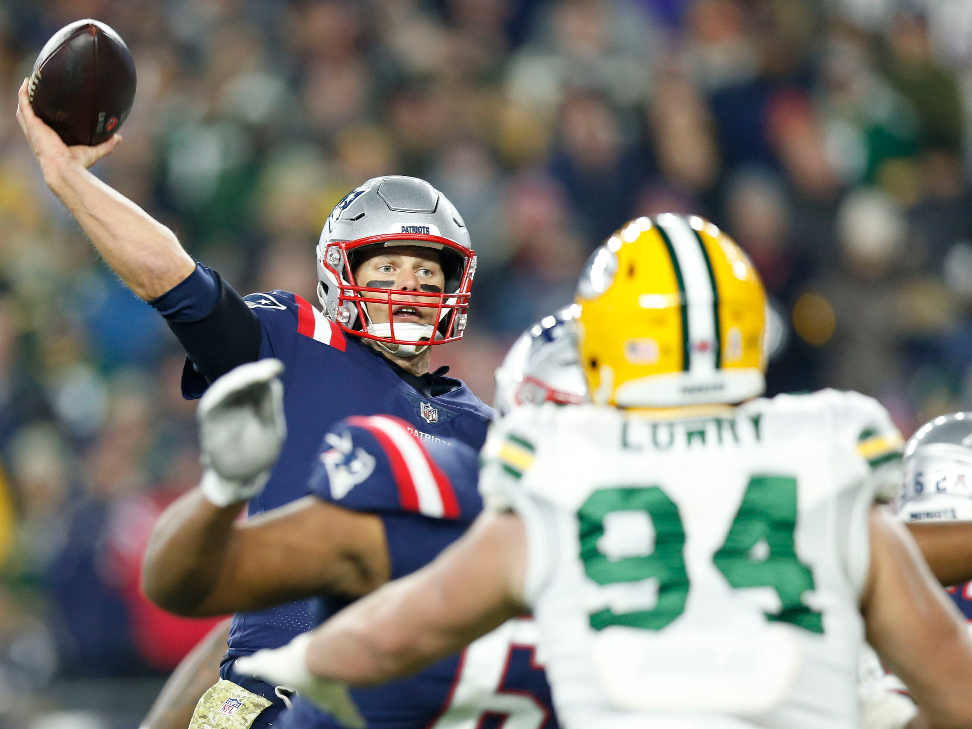 New England Patriots quarterback Tom Brady makes a pass during the third quarter against the Green Bay Packers at Gillette Stadium.