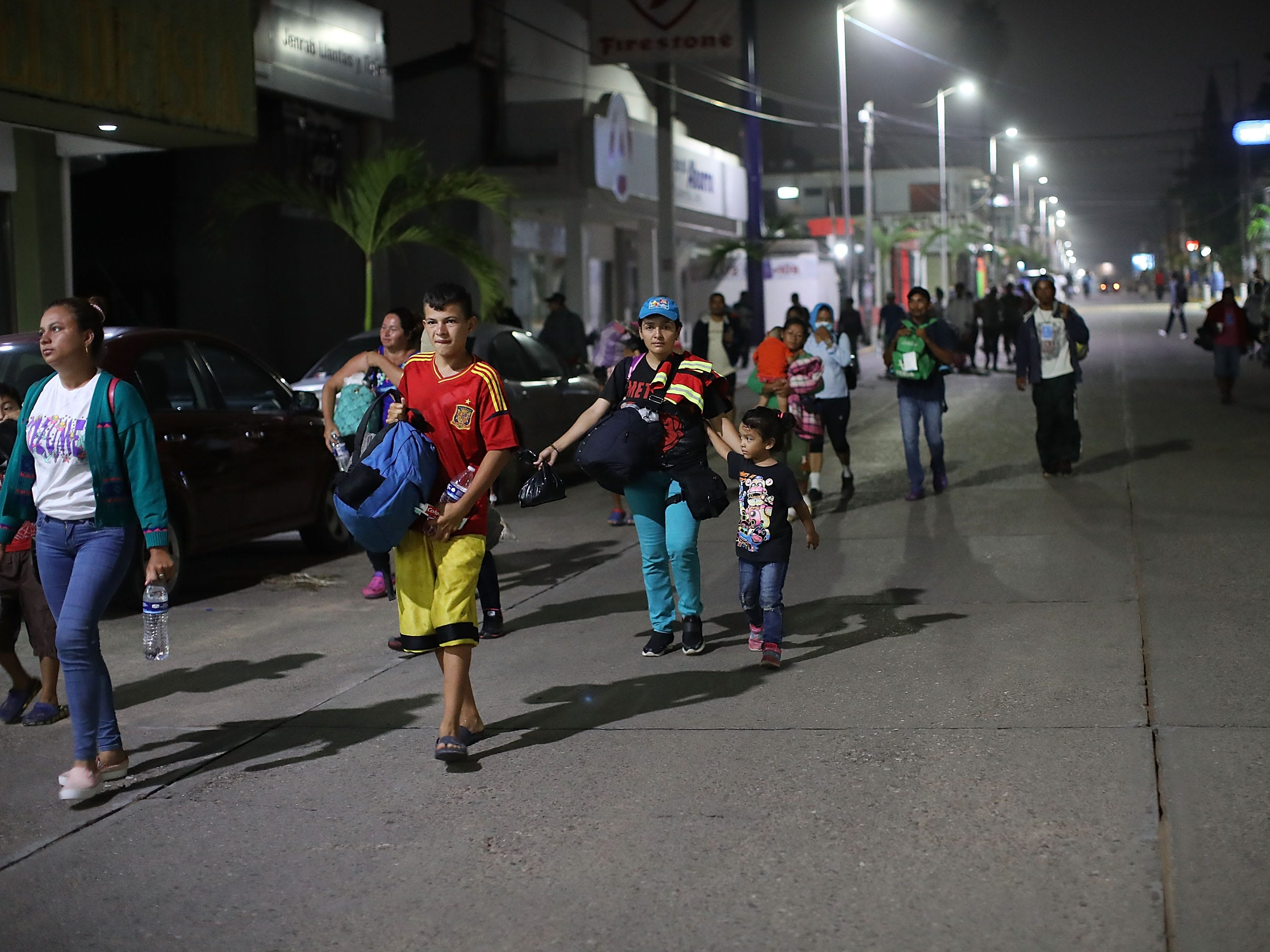 Hundreds of members of the Central American migrant caravan move in the early hours toward their next destination on Nov. 04, 2018 in Isla, Mexico.