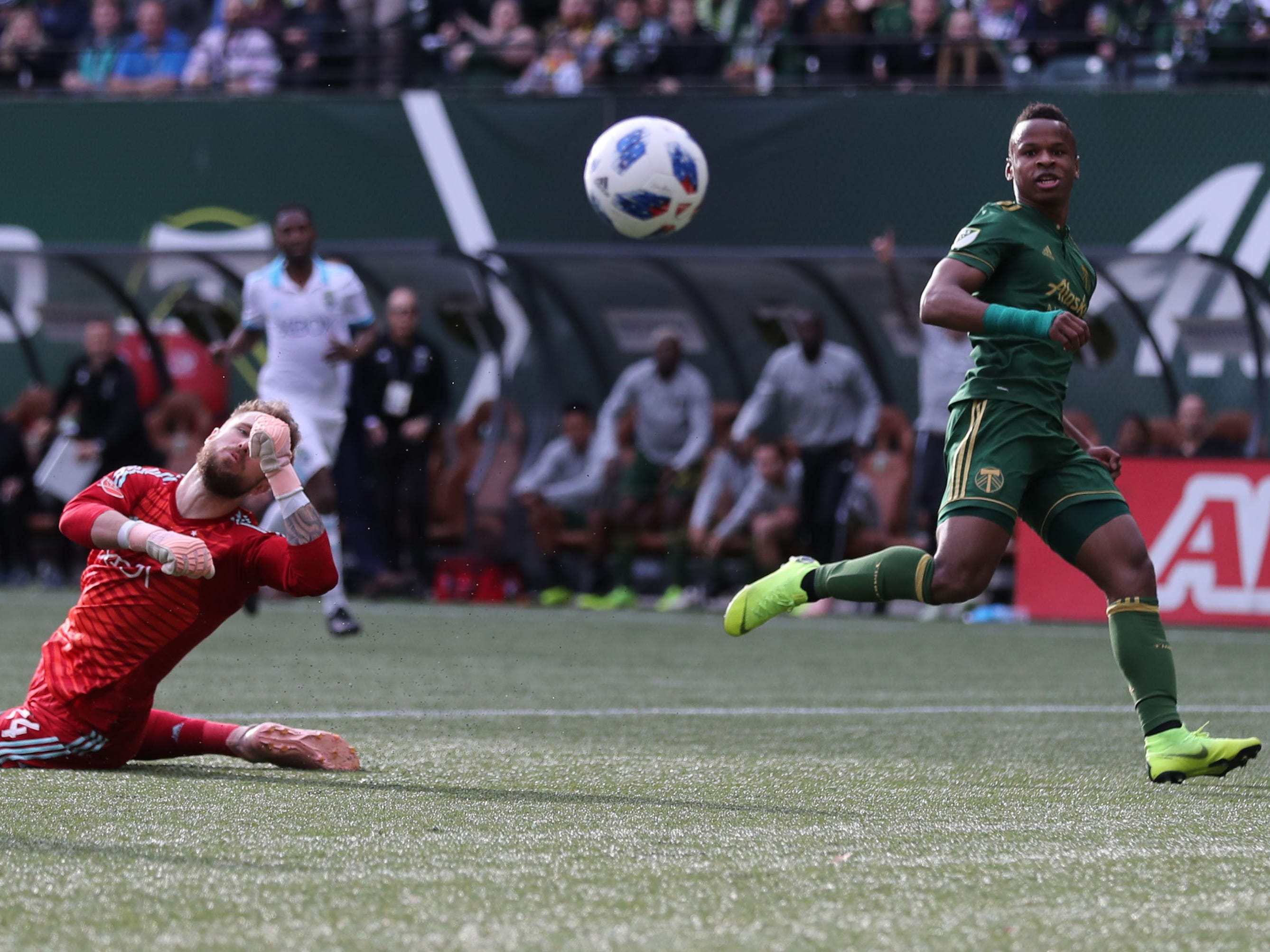 Portland Timbers forward Jeremy Ebobisse kicks the ball over Seattle Sounders goalkeeper Stefan Frei for a goal in the first half at Providence Park.
