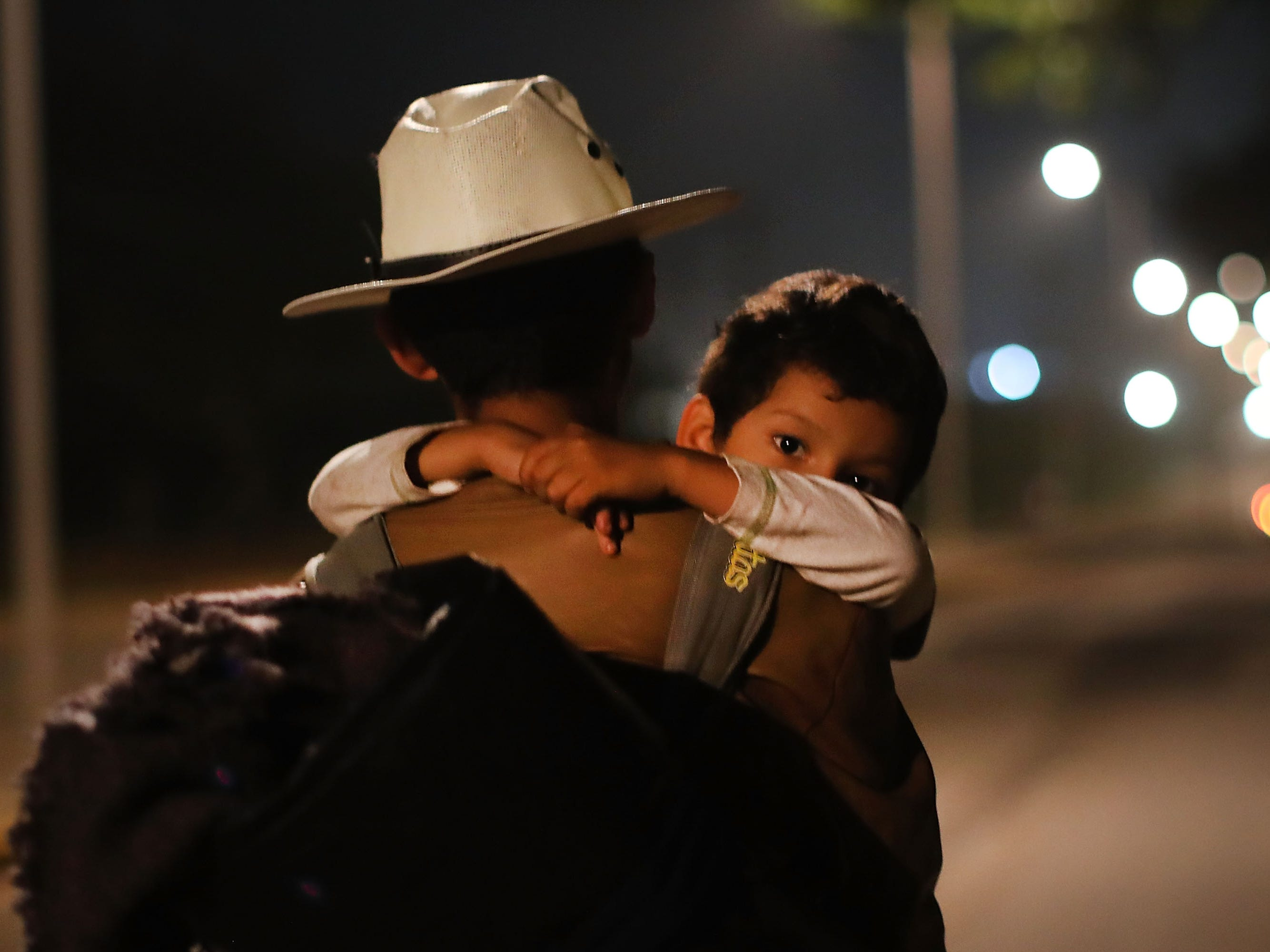 Hundreds of members of the Central American migrant caravan move in the early hours toward their next destination on Nov. 04, 2018, in Isla, Mexico. The group of migrants, many of them fleeing violence in their home countries, last took a rest day on Wednesday and have resumed their march to the United States border. As fatigue from the heat, distance and poor sanitary conditions has set in, the number of people participating in the march has slowly dwindled, but a significant group are still determined to get to the United Sates. The U.S. will deploy more than 5,000 active-duty troops to the U.S.-Mexico border in an effort to prevent members of the migrant caravan from illegally entering the country.
