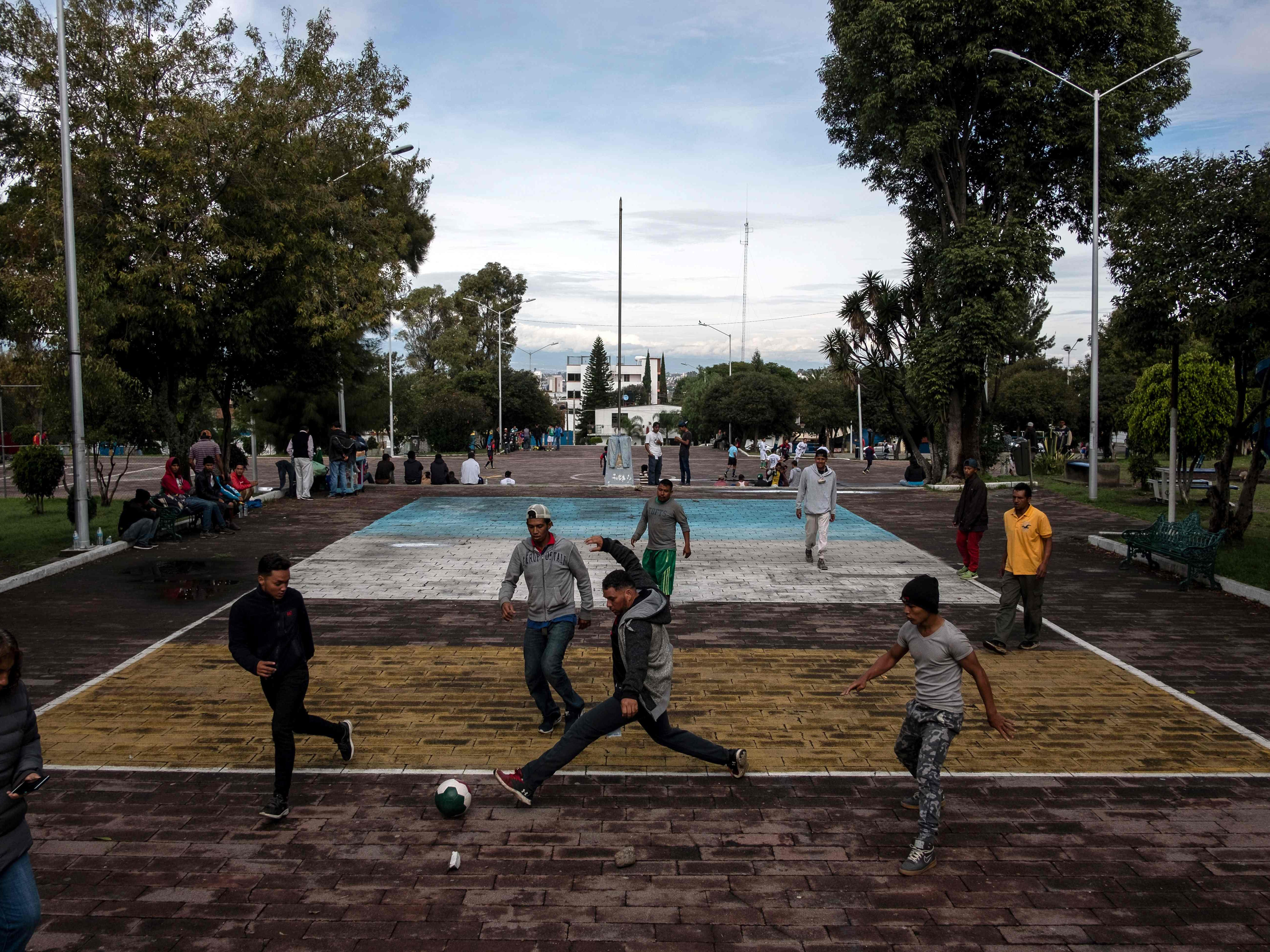Migrants taking part in a caravan heading to the U.S., play at a park outside at the Asuncion temple in Puebla, Puebla state, Mexico, on Nov. 4, 2018.