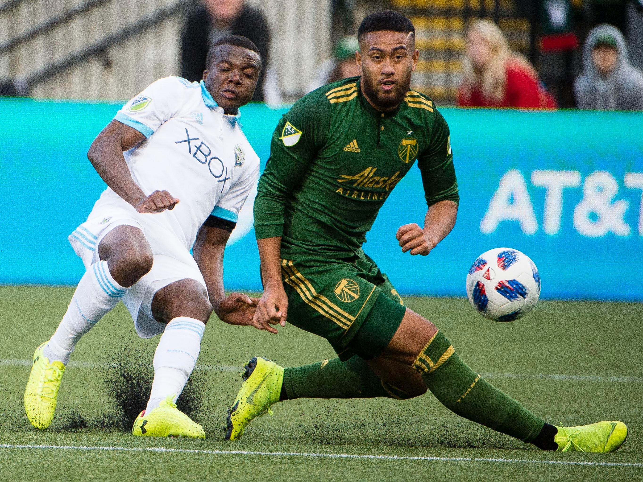 Portland Timbers defender Bill Tuiloma blocks a shot on goal by Seattle Sounders defender Nouhou Tolo during the first half at Providence Park. Portland won the game, 2-1.
