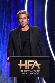 Brad Pitt speaks presents an award at the Hollywood Film Award.