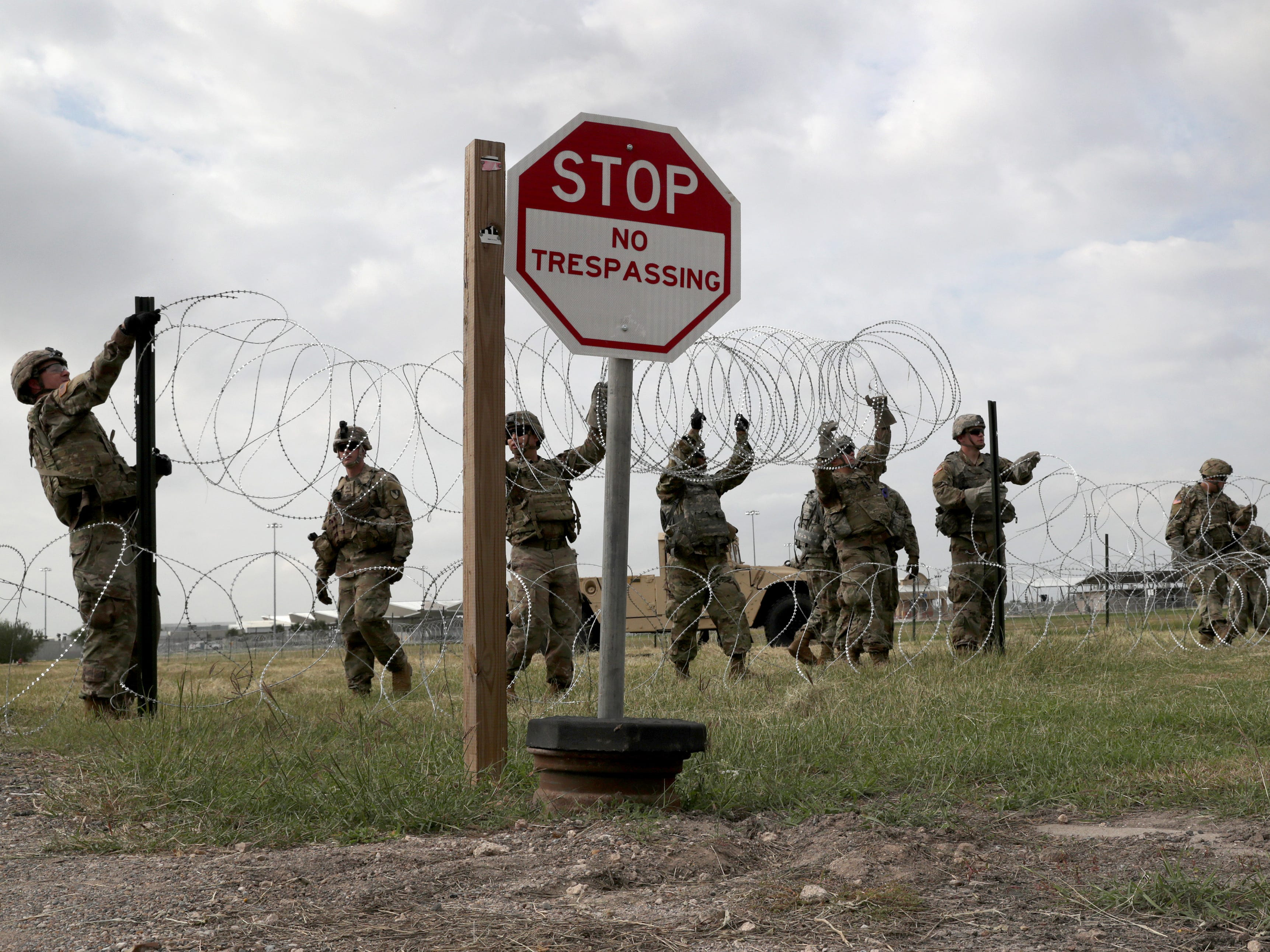 U.S. Army soldiers from Ft. Riley, Kansas string razor wire near the port of entry at the U.S.-Mexico border on Nov. 4, 2018 in Donna, Texas. President Trump ordered the troops to border areas ahead of the possible arrival of an immigrant caravan in upcoming weeks.