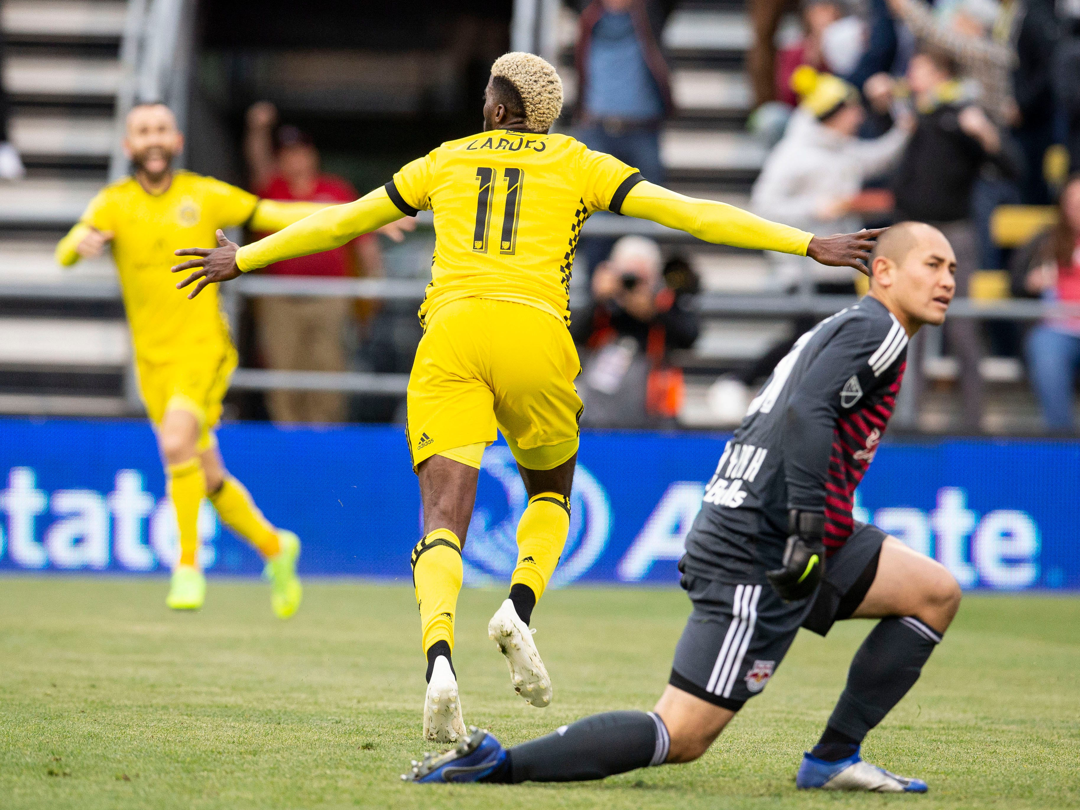 Columbus Crew SC forward Gyasi Zardes (11) celebrates after scoring against New York Red Bulls goalkeeper Luis Robles (31) at Mapfre Stadium.