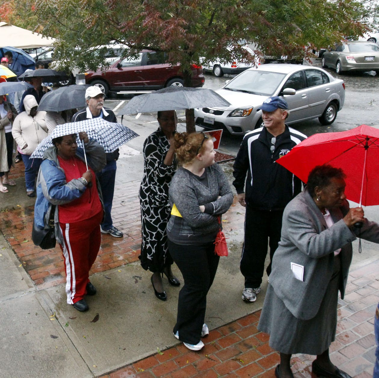 Voters wait in line despite rains from Hurricane Sandy to vote on the last early voting Sunday before Election Day, in New Bern, N.C., on Oct. 28, 2012.  In 2018, a rainy Election Day is expected in the East.