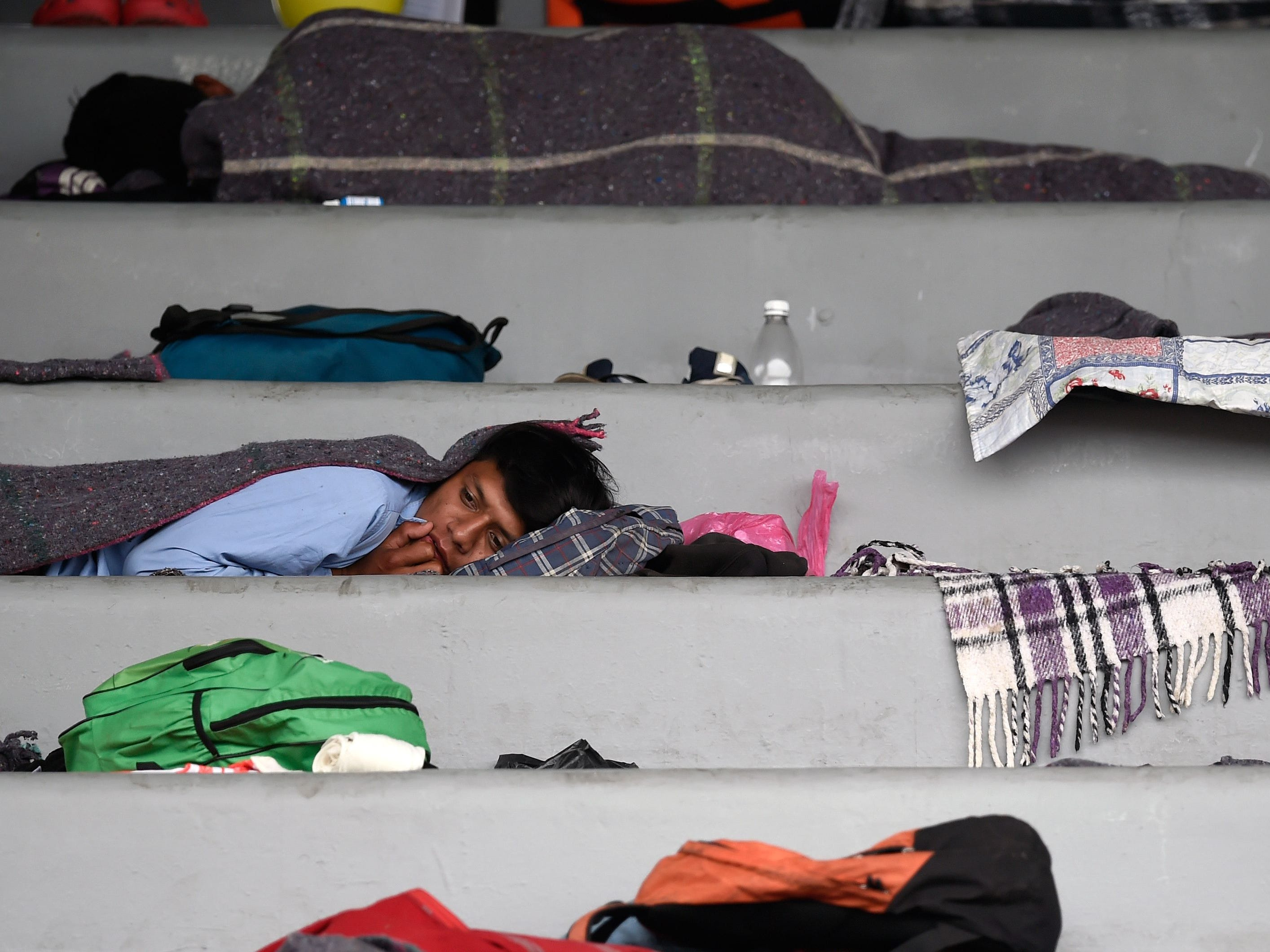 Migrants from Central American countries  headed towards the United States in hopes of a better life or to escape violence make a stop at a temporary shelter at a sports complex in Mexico City, on Nov. 4, 2018.
