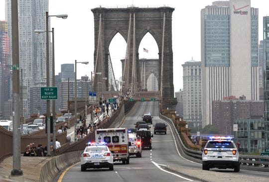 In this file photo taken on October 10, 2018 Mexican drugs kingpin Joaquin 'El Chapo' Guzman is escorted by police motorcade across the Brooklyn Bridge back to jail in lower Manhattan after his court appearance in Federal District Court  in Brooklyn.