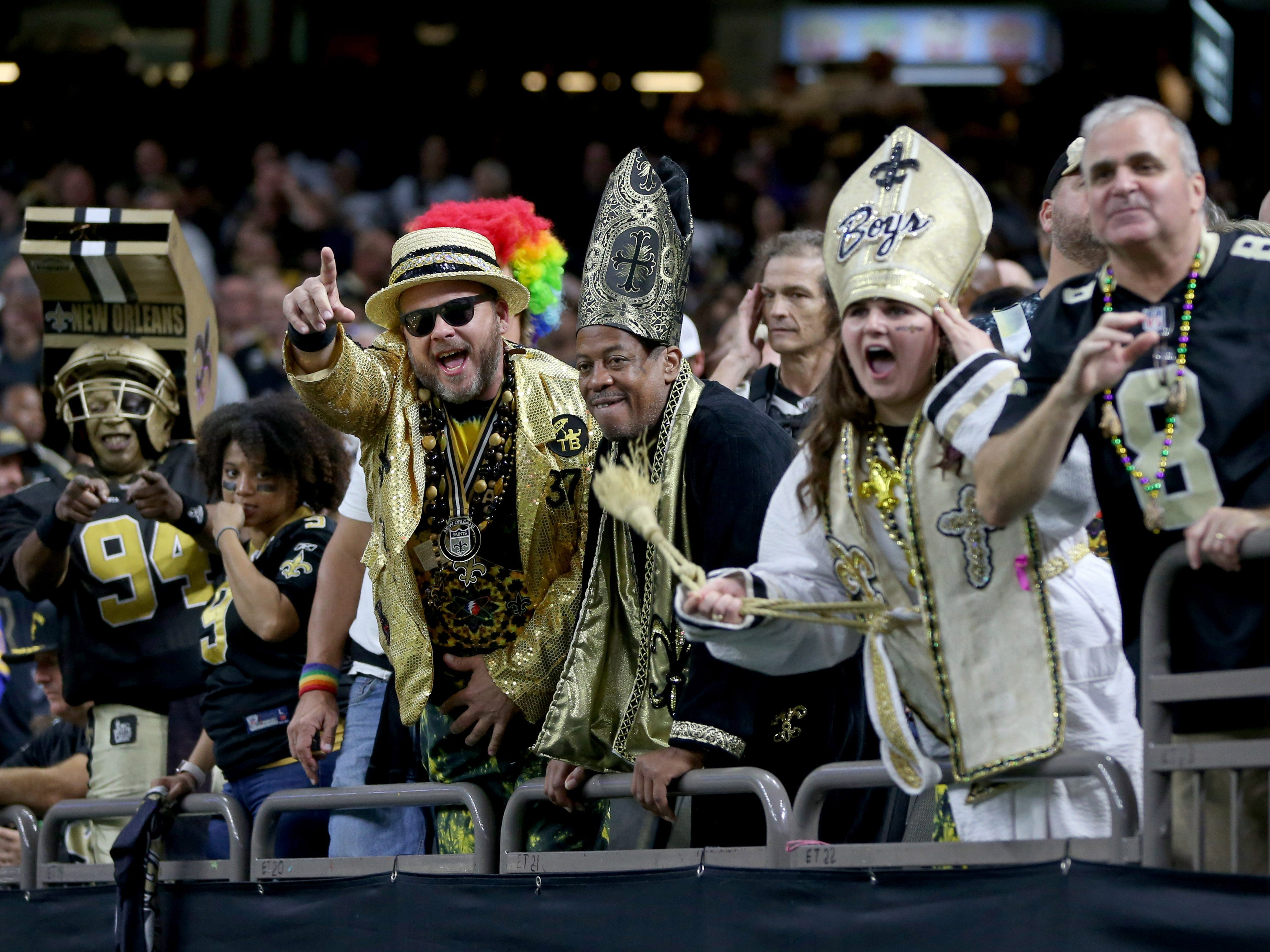 New Orleans Saints fans cheer during the second quarter of their game against the Los Angeles Rams at the Mercedes-Benz Superdome.