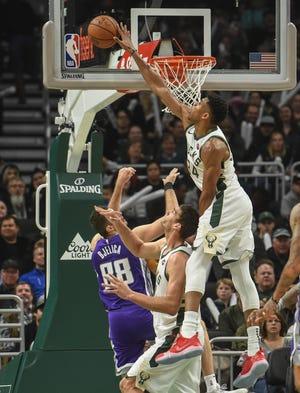Milwaukee Bucks forward Giannis Antetokounmpo (34) blocks a shot by Sacramento Kings forward Nemanja Bjelica.