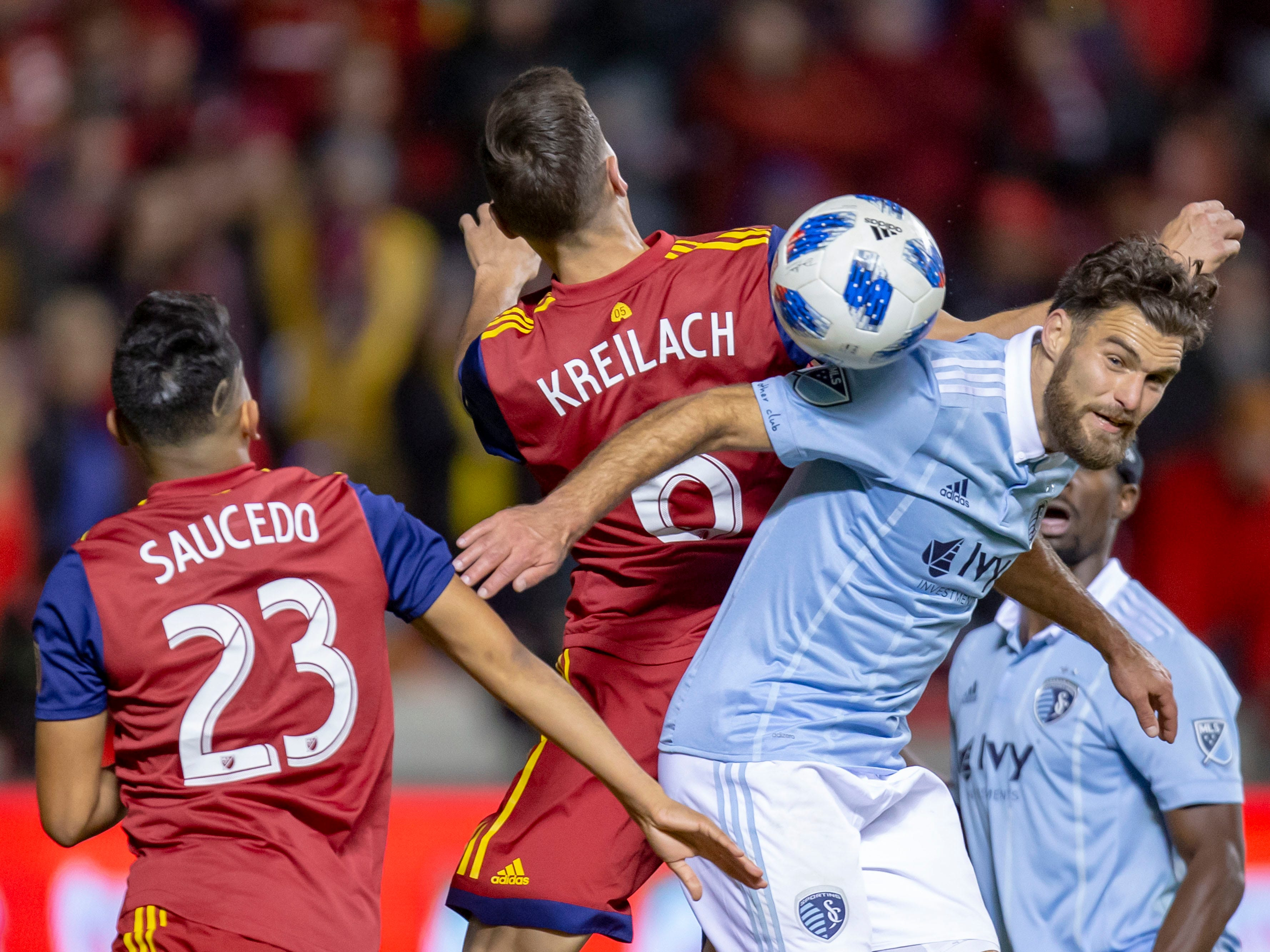 Real Salt Lake midfielder Damir Kreilach (6) and Sporting Kansas City midfielder Graham Zusi (8) play for a ball during the second half at Rio Tinto Stadium.