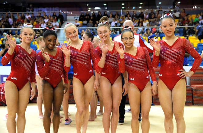From left, Ragan Smith, Simone Biles, Riley McCusker, Grace McCallum, Morgan Hurd and Kara Eaker celebrate after the women's team final of the Gymnastics World Championships at the Aspire Dome in Doha, Qatar, Oct. 30, 2018.