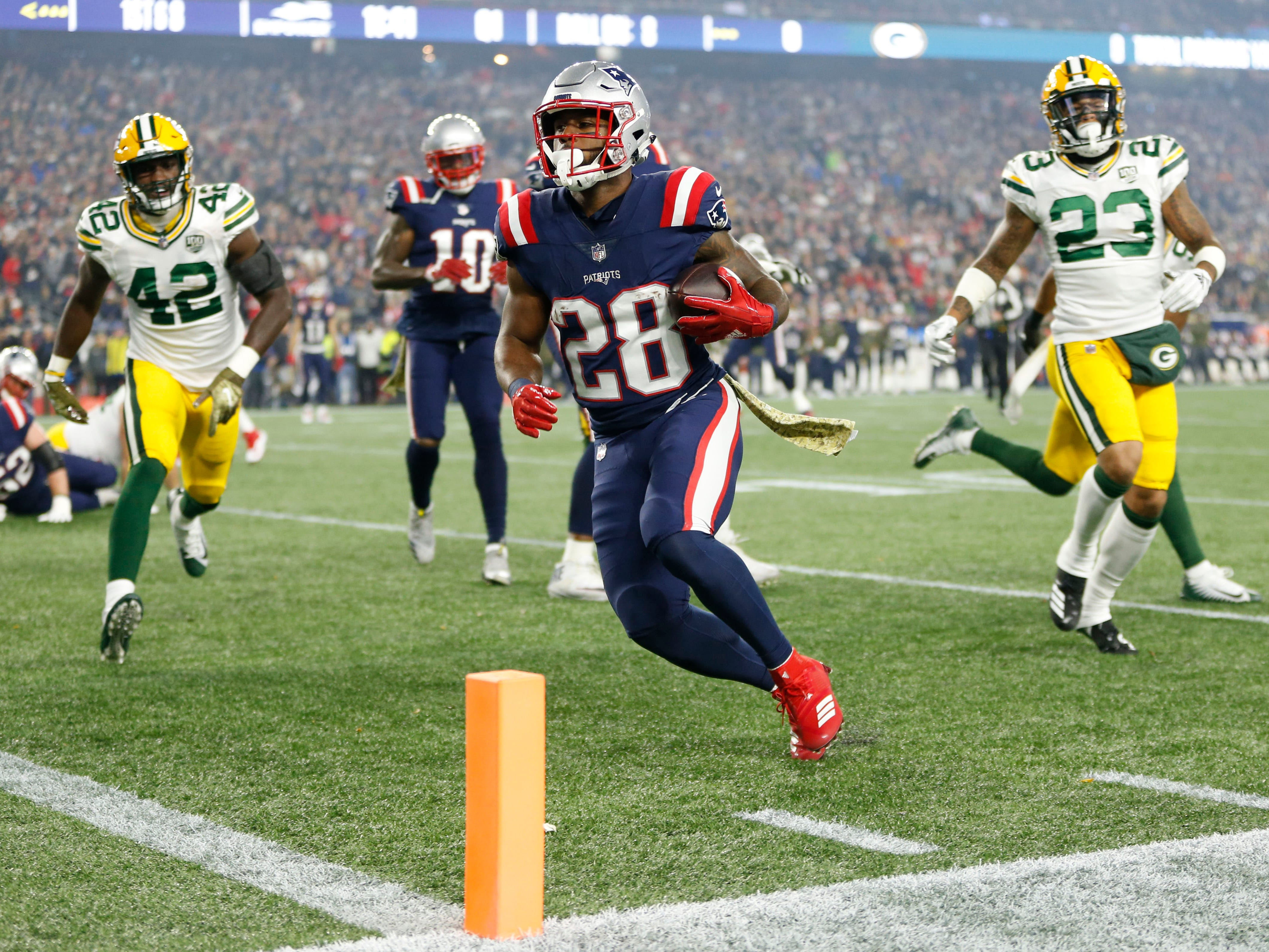 New England Patriots running back James White rushes for a touchdown during the first quarter against the Green Bay Packers at Gillette Stadium.