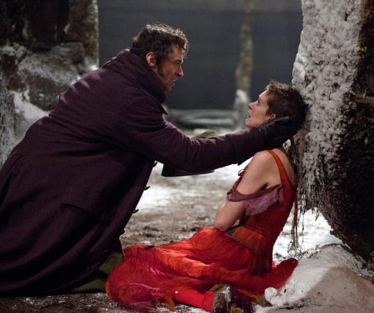 "Working on ""Les Miserables"" took a toll. Hugh Jackman and Anne Hathaway in a scene from the 2012 musical."