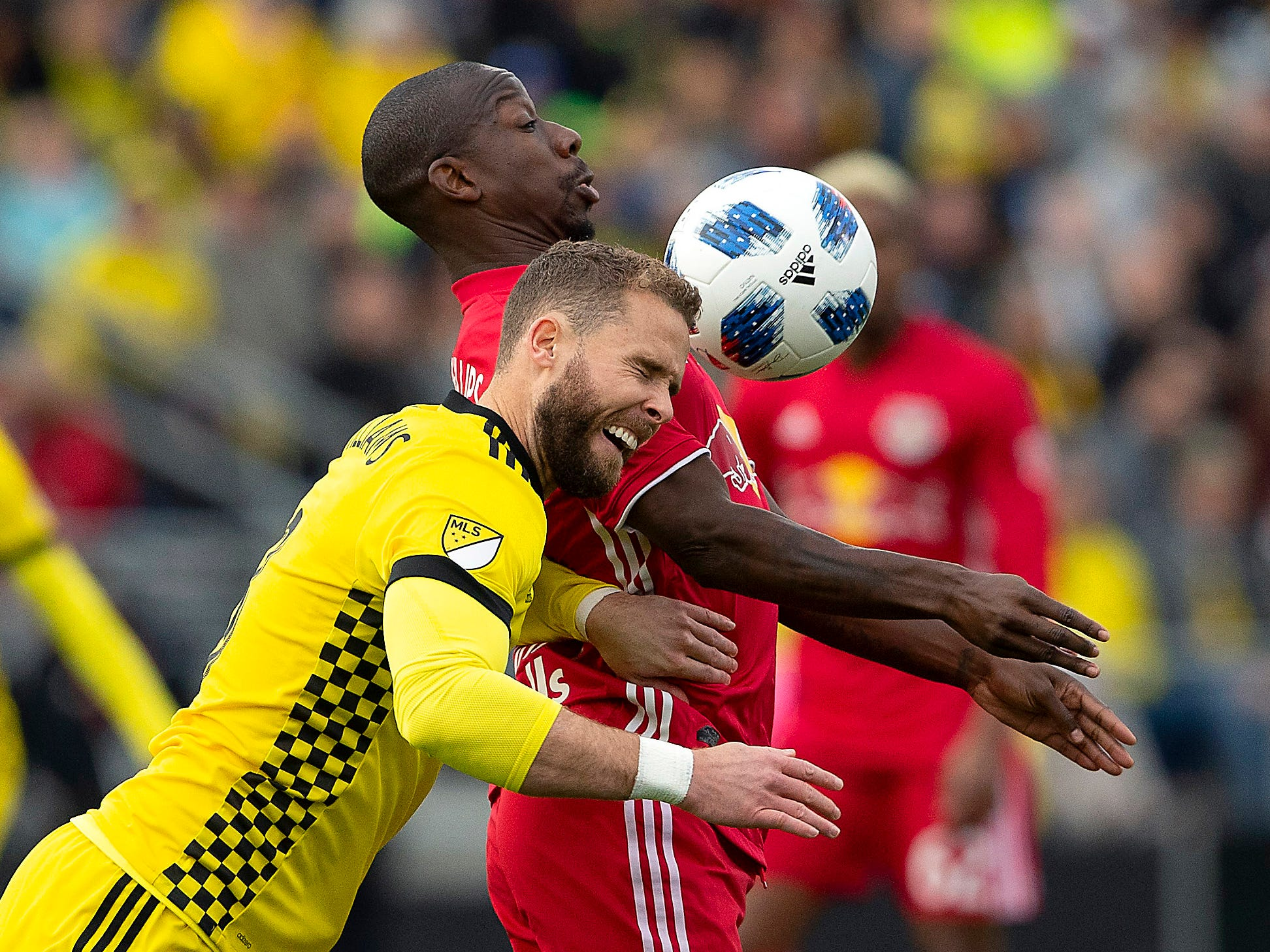 Columbus Crew SC defender Josh Williams goes up for a header against New York Red Bulls forward Bradley Wright-Phillips during the first half at Mapfre Stadium.