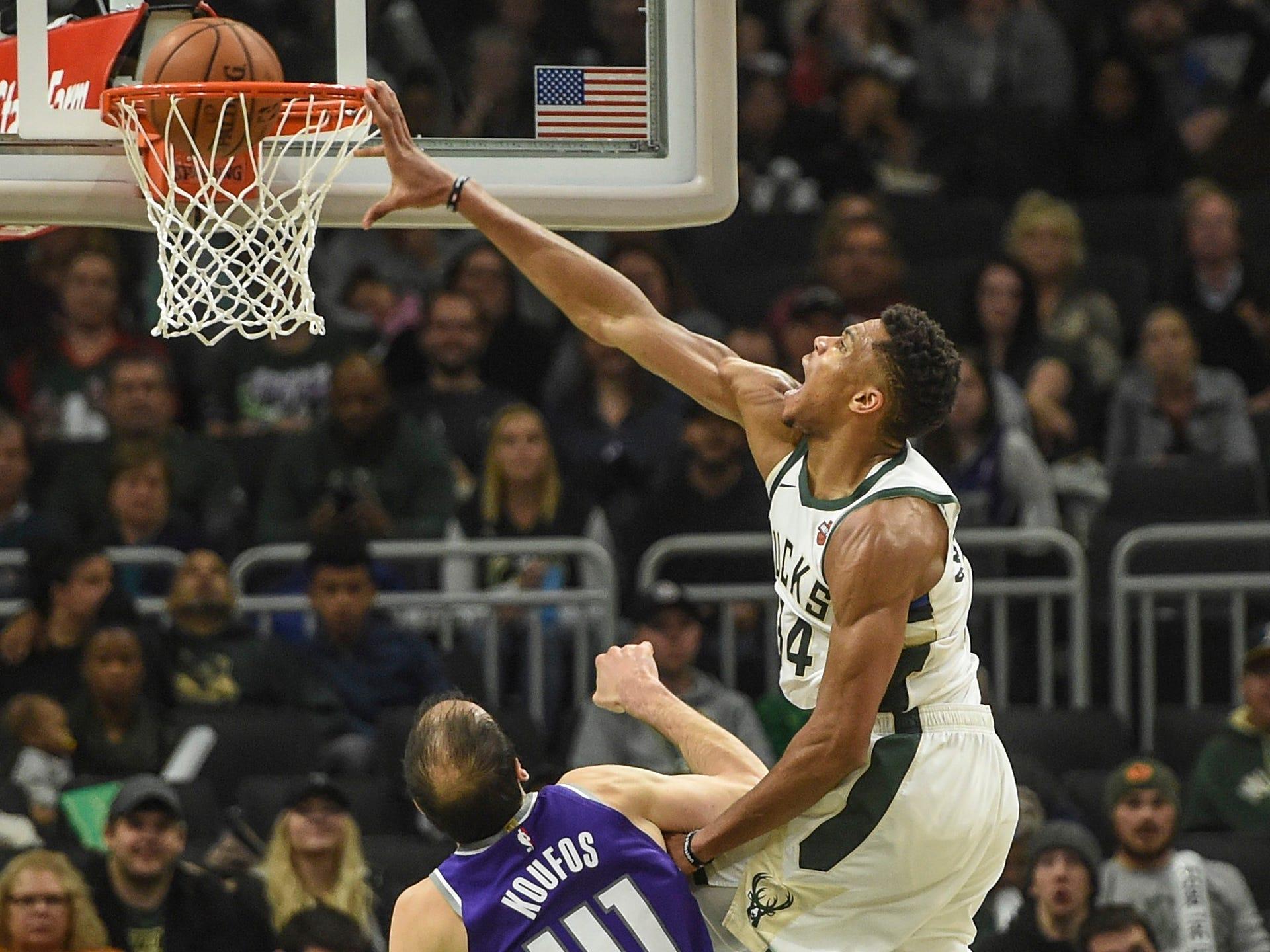 Nov. 4: Bucks forward Giannis Antetokounmpo (34) throws down a ferocious one-handed slam over Kings defender Kosta Koufos (41) during the second half in Milwaukee.