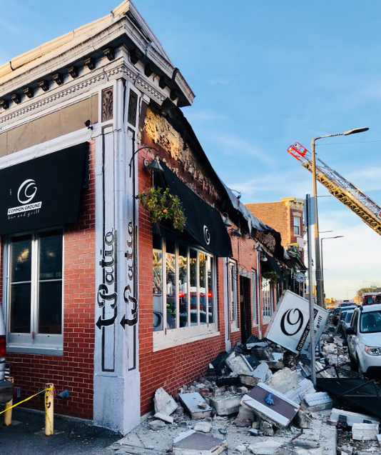 collapse of boston building housing a bar and restaurant injures two