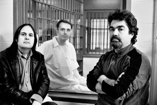 "Directors of the documentary motion picture  ""Paradise Lost 3: Purgatory"" Joe Berlinger, left, and Bruce Sinofsky, sit with Damien Echols on death row in 2009."