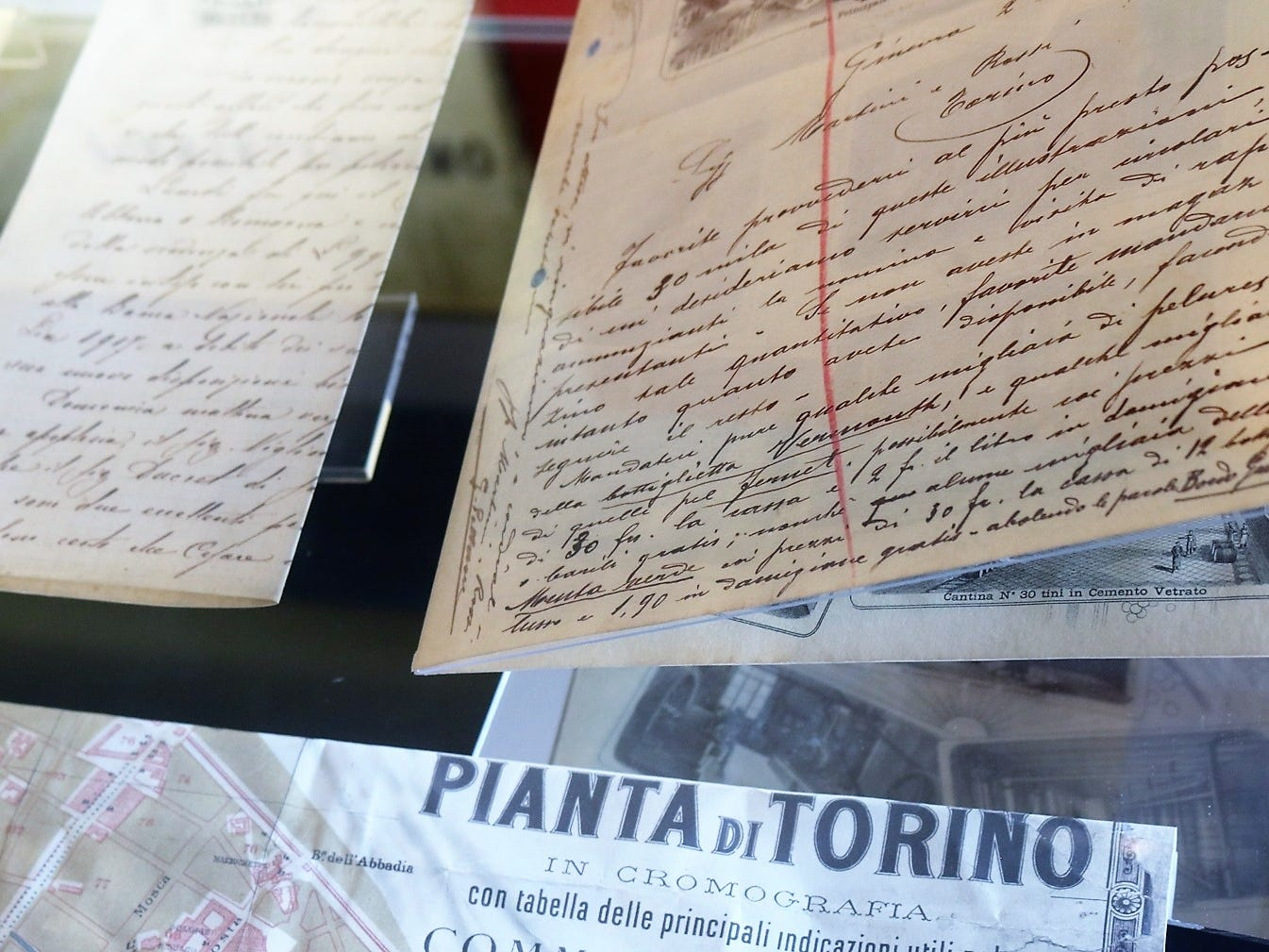 The gallery at Mondo Martini displays a collection of original correspondence, company ledgers and records, and a range of historical documents.