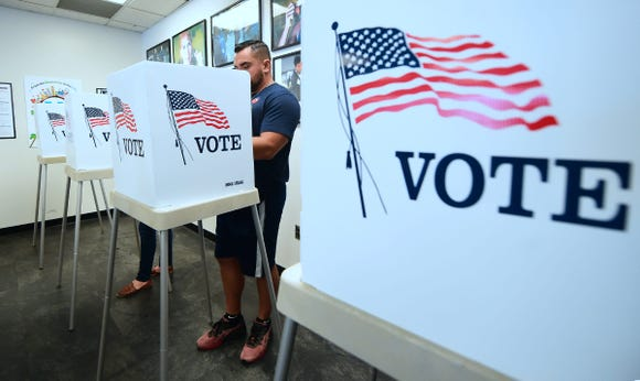 Voters cast their ballots for Early Voting at the Los Angeles County Registrar's Office in Norwalk, California on November 5, 2018, a day ahead the November 6 midterm elections.