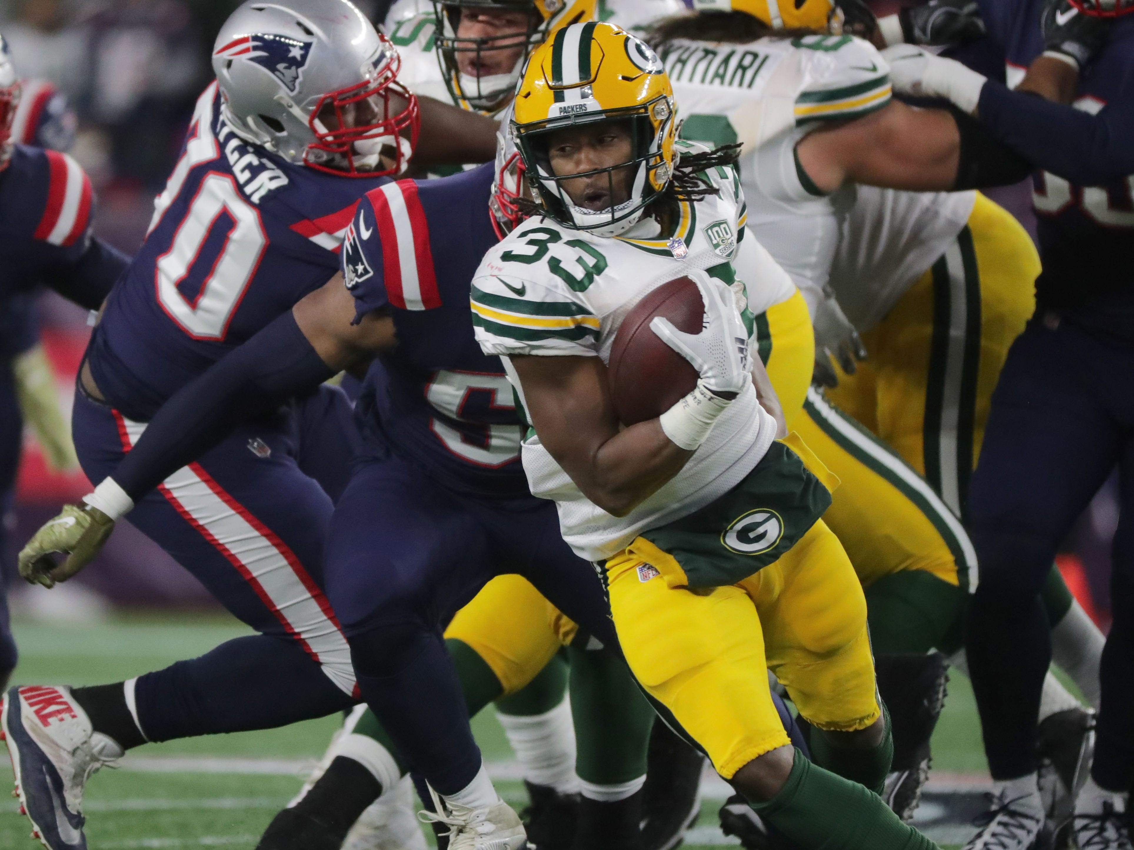 Green Bay Packers running back Aaron Jones spins after getting stopped at the line of scrimmage during the second quarter of their game against the New England Patriots  at Gillette Stadium.