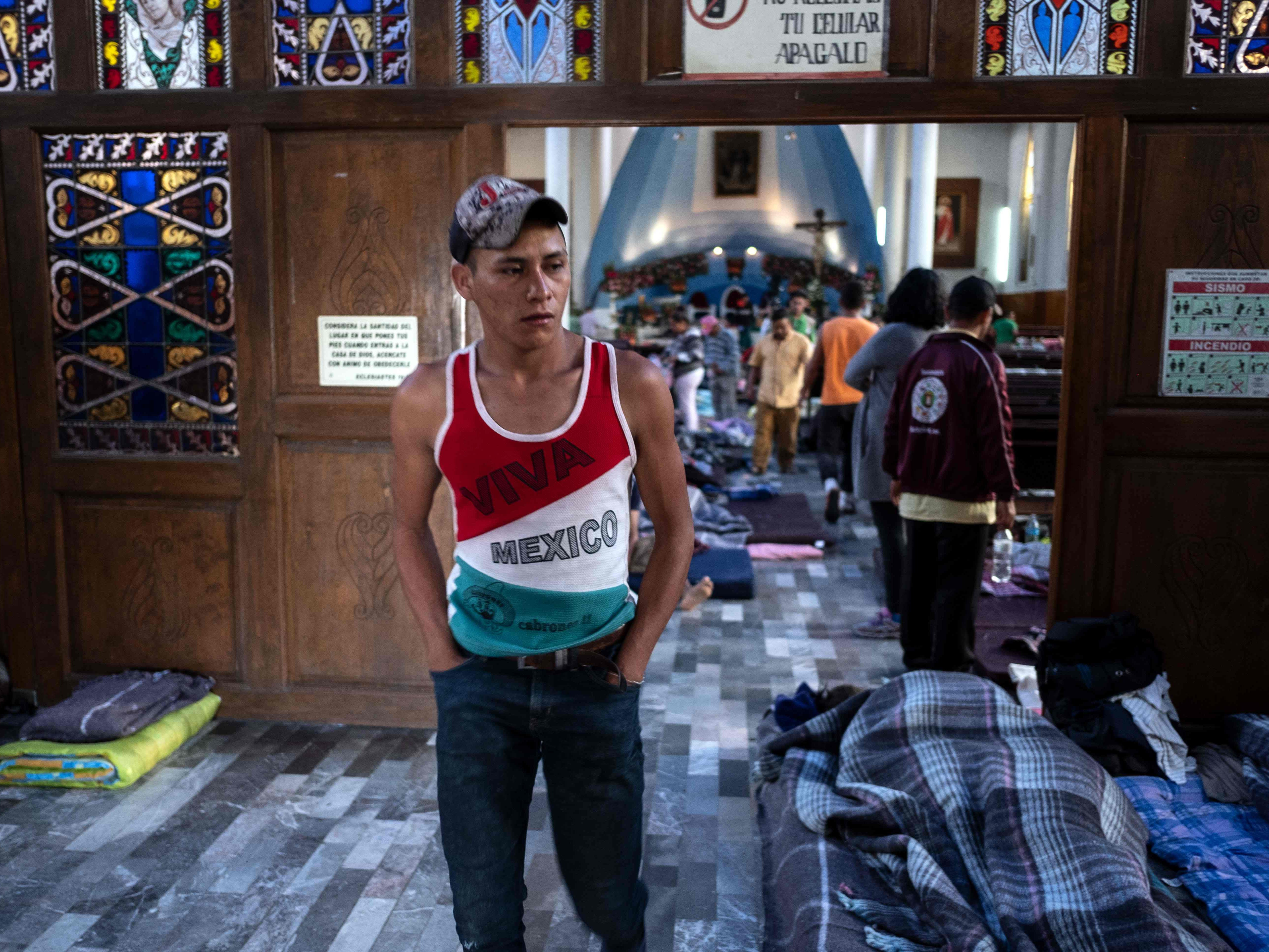 A migrant taking part in a caravan heading to the US, stands in the Asuncion temple, outfitted as a temporary shelter, in Puebla, Puebla state, Mexico, on Nov. 4, 2018.