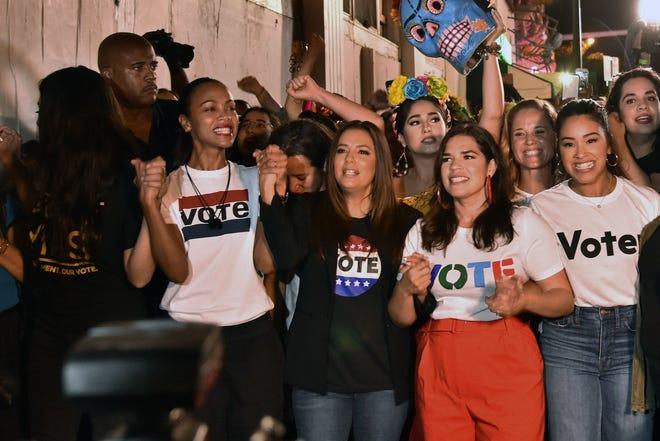 "Rosario Dawson, Zoe Saldana, Eva Longoria, America Ferrera and Gina Rodriguez march down Calle Ocho during ""Latinas en Marcha"", en election rally with other Latin American celebrities in Miami, Florida on November 4, 2018."