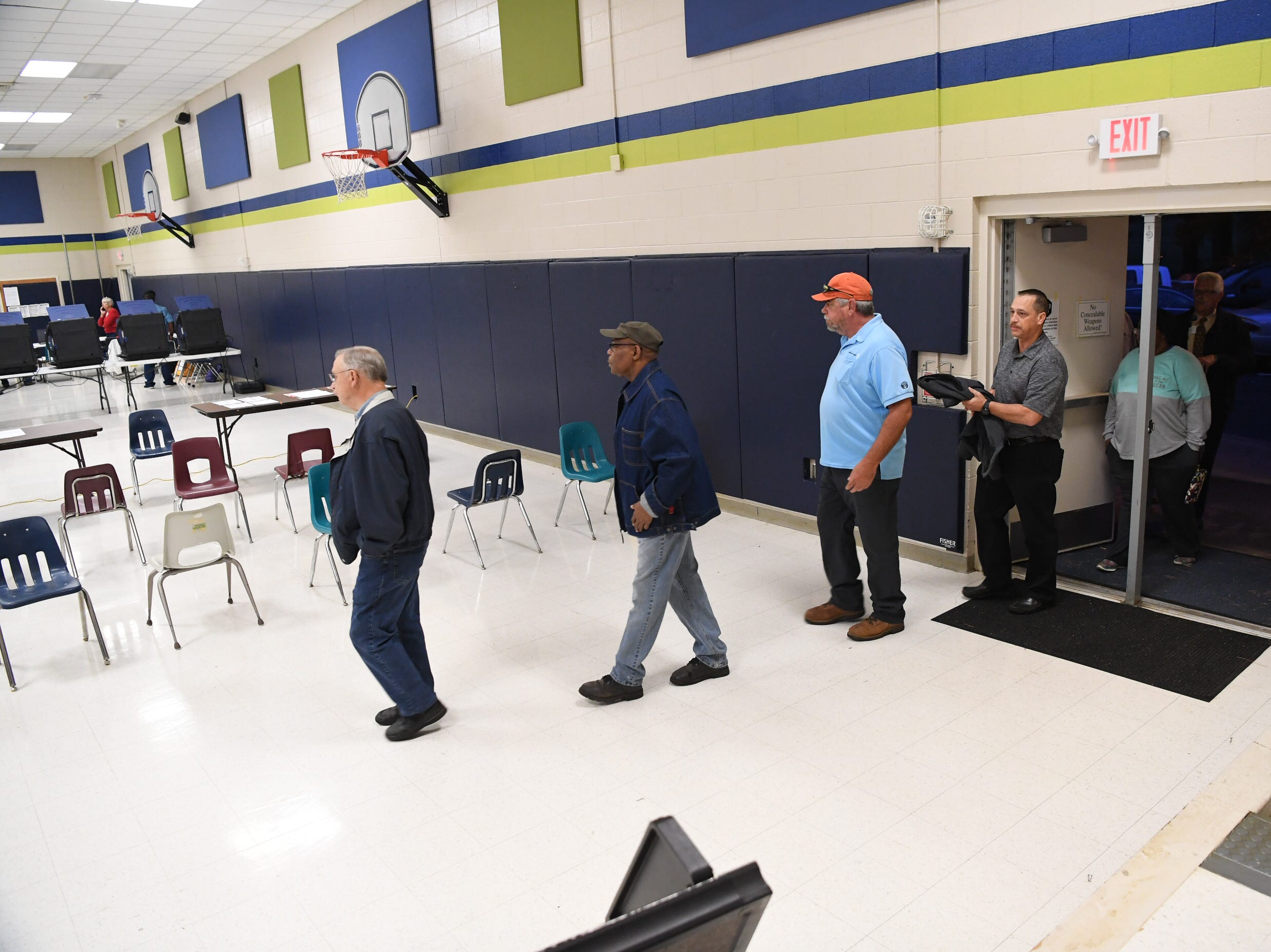 First voters of the day enter Centerville precinct in Anderson County, one of the largest, on Tuesday, Nov. 8, 2018, as South Carolina voters cast their ballots in the 2018 midterm elections.