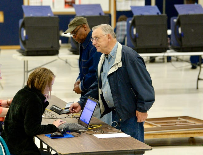 Ken McKinney, the first voter at Centerville precinct in Anderson County,  checks in on Tuesday, Nov. 6, 2018, as South Carolinians voted in the 2018 midterm elections.