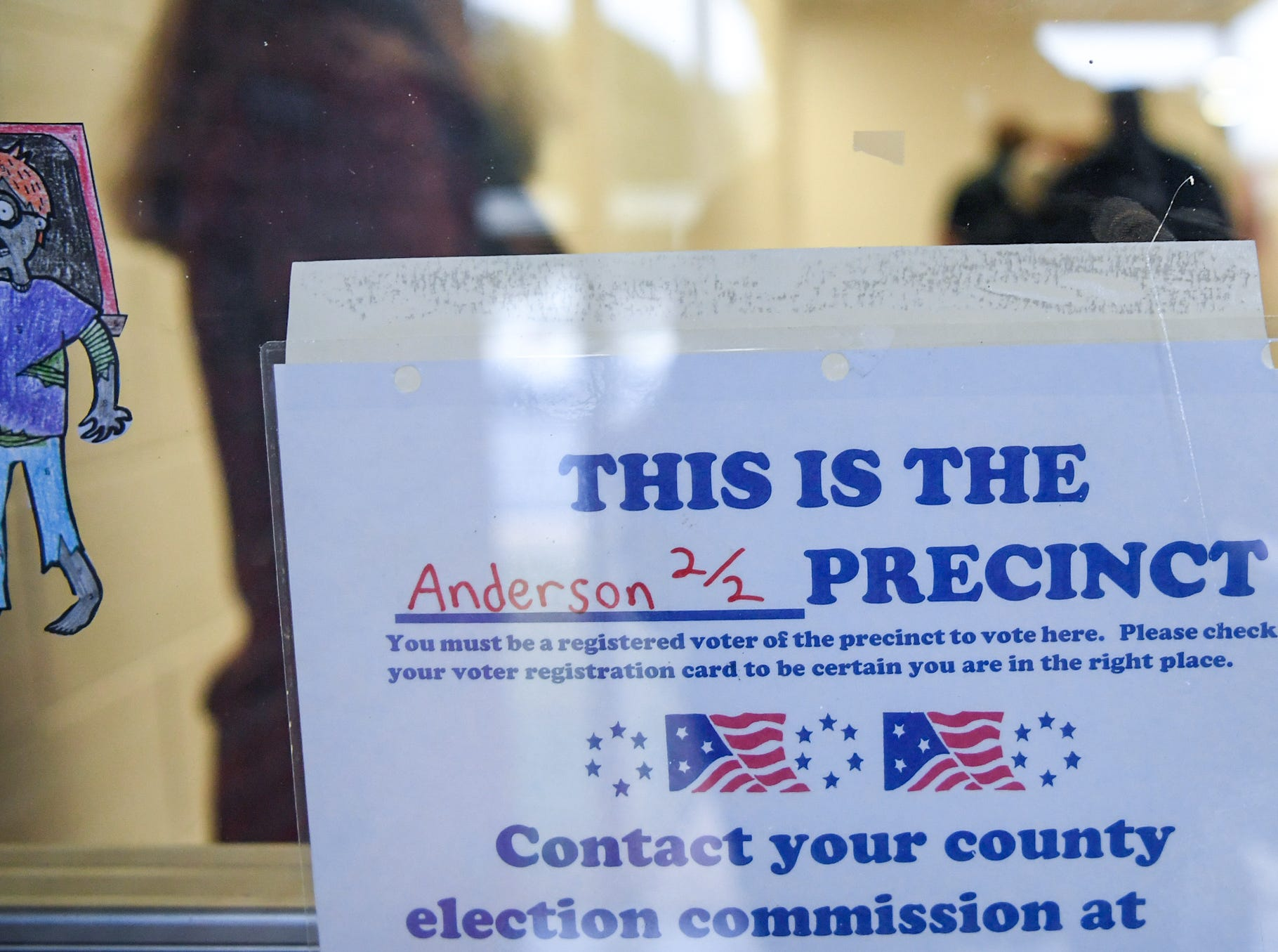 A sign leading to the hallway at McCants Middle School precinct during election day in Anderson County on Tuesday, November 6, 2018.
