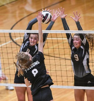 T.L. Hanna sophomores Megan Vickery (11) and Rylee Moorhead (9) block a ball from Nation Ford freshman Taylor Atkinson (8) during the first set of the Class AAAAA Upper State final at T.L.  Hanna High School in Anderson on Tuesday, November 6, 2018.