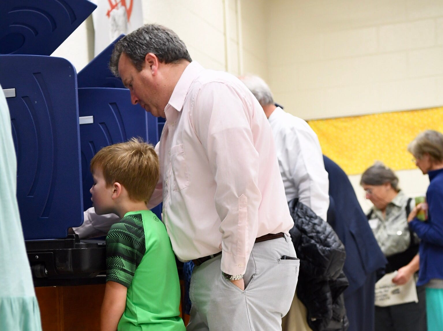Dave Brousseau votes with his son Davis observing on his toes at the McCants Muddle School precinct in Anderson on Tuesday.