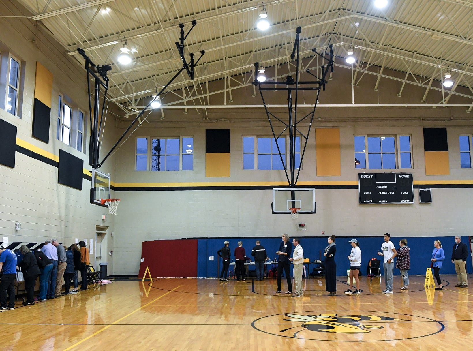 Voters line up at T.L. Hanna High School auxiliary gymnasium for last hour voting in the midterm elections in Anderson on Tuesday. Polling with an hour to go showed 55-percent with over 900 voters at the precinct.