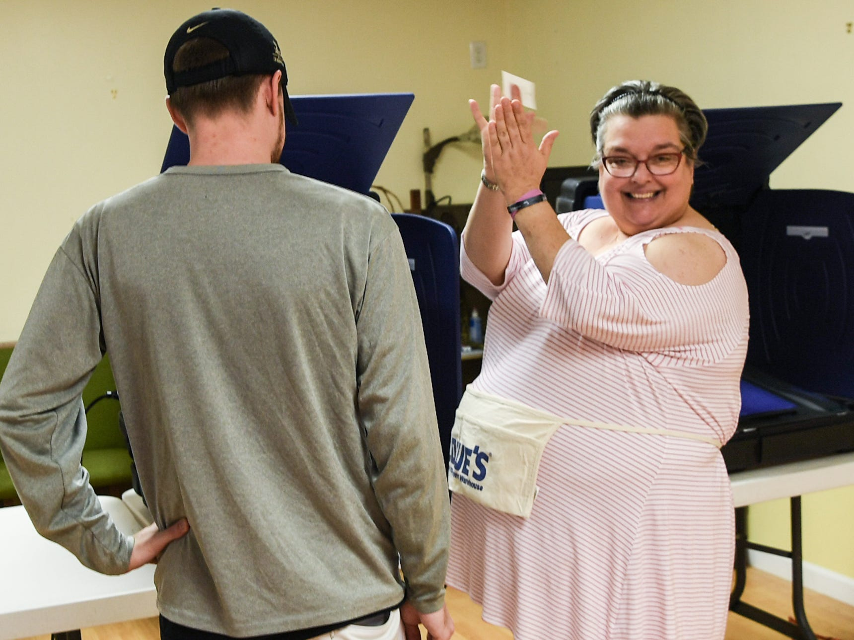 Pam Stansell, poll manager for Anderson Precinct 6/1, cheers for first time voter Ryan Howard at Trinity United Methodist Church in Anderson on Tuesday, November 6, 2018. By 1 p.m., 536 voted at the precinct.