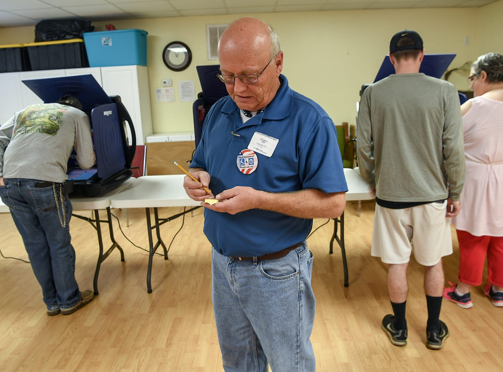 John Elsea, poll clerk for Anderson Precinct 6/1, keeps a tally of voter totals up through lunch, where people vote at Trinity United Methodist Church in Anderson on Tuesday, November 6, 2018. By 1 p.m., 536 voted at the precinct.