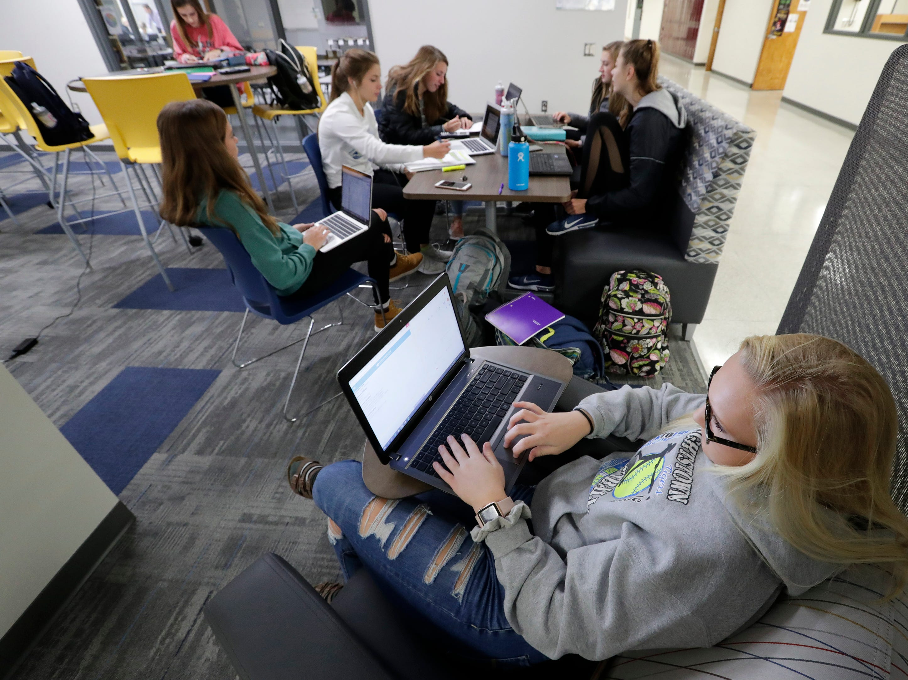 Senior Molly Romenesko does homework in a collaboration area in Little Chute High School Tuesday, November 6, 2018, in Little Chute, Wis. The areas are for students and teachers to work together in small groups in a comfortable space