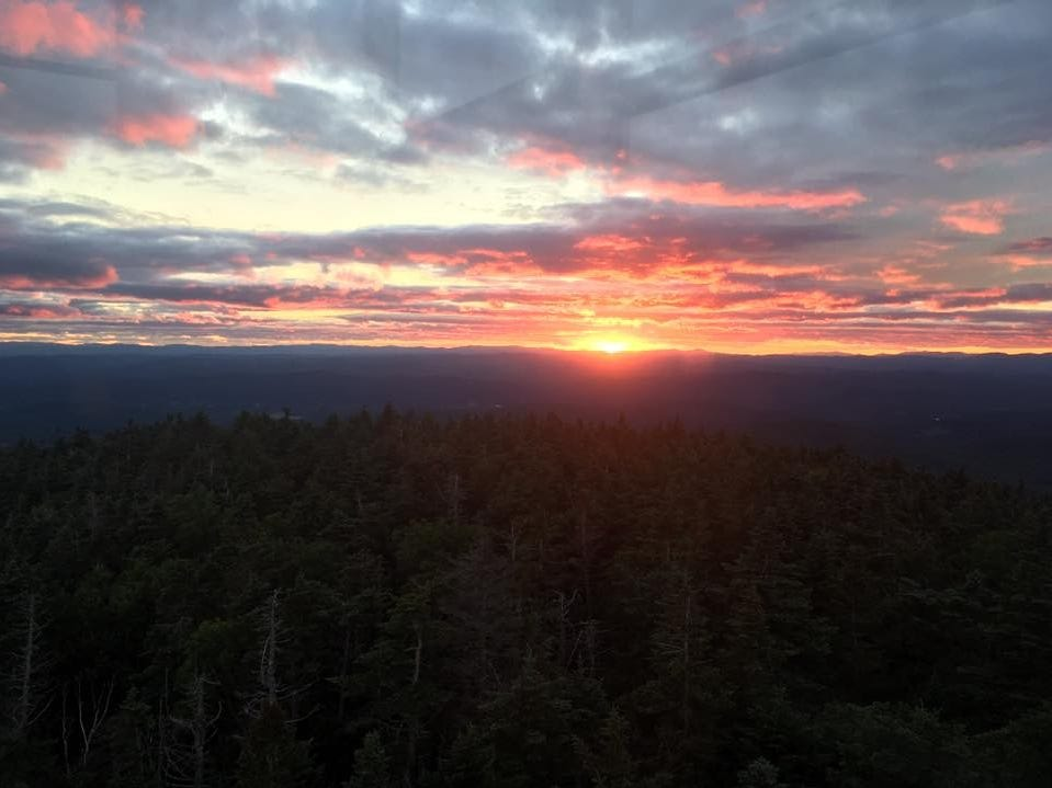 "Zach Jones, of Appleton, on this view from the Appalachian Trail: ""Sunset from the fire tower on Smarts Mountain in New Hampshire."""