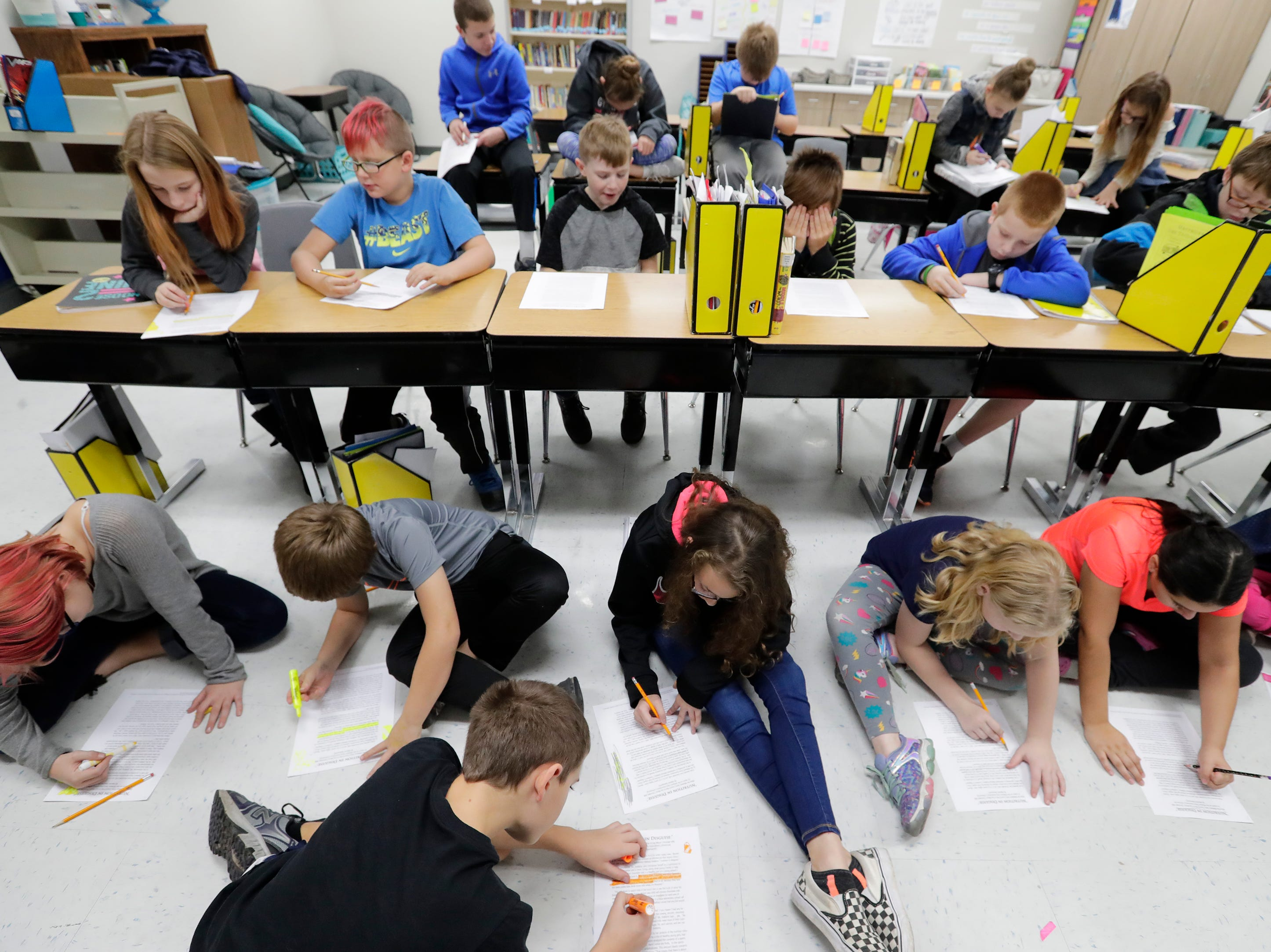 Allison Johnson's fifth grade class works on a project in their new room in the Little Chute Intermediate School Tuesday, November 6, 2018, in Little Chute, Wis. 