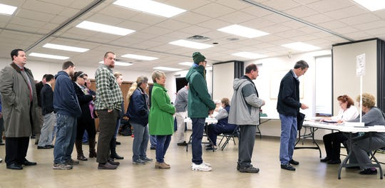 Voters cast their ballots in the midterm elections at Prince of Peace Lutheran Church on Tuesday in Appleton.