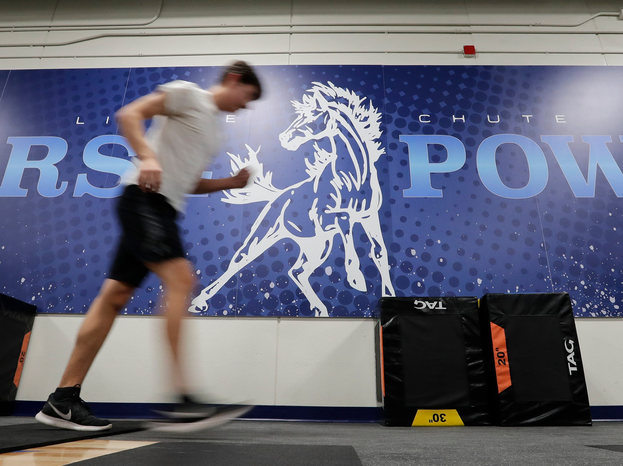 A student participates in the Intro to Strength and Conditioning class in the new fitness center at Little Chute High School Tuesday, November 6, 2018, in Little Chute, Wis. 