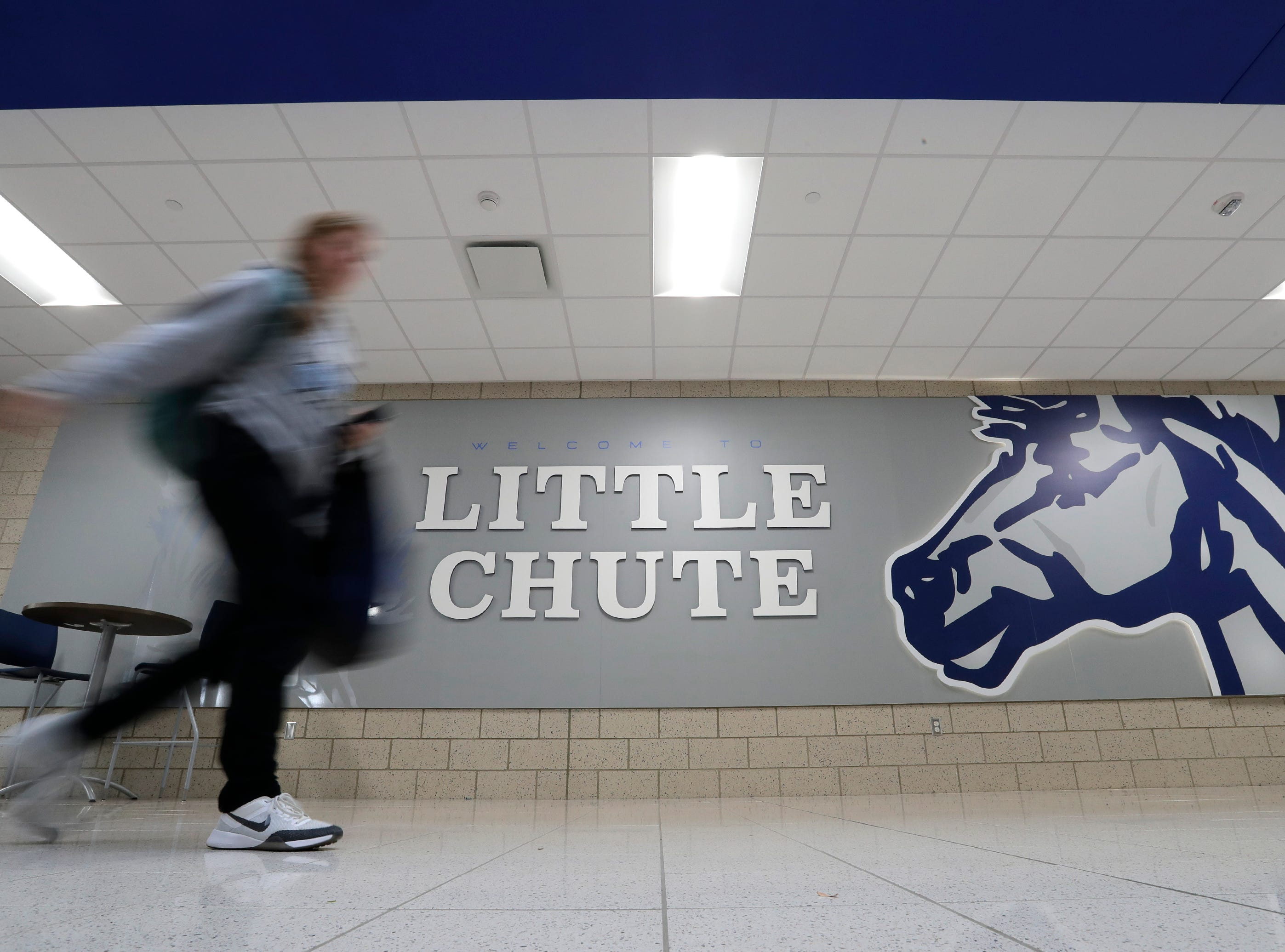 A student walks down the new entrance hallway of Little Chute High School Tuesday, November 6, 2018, in Little Chute, Wis. 