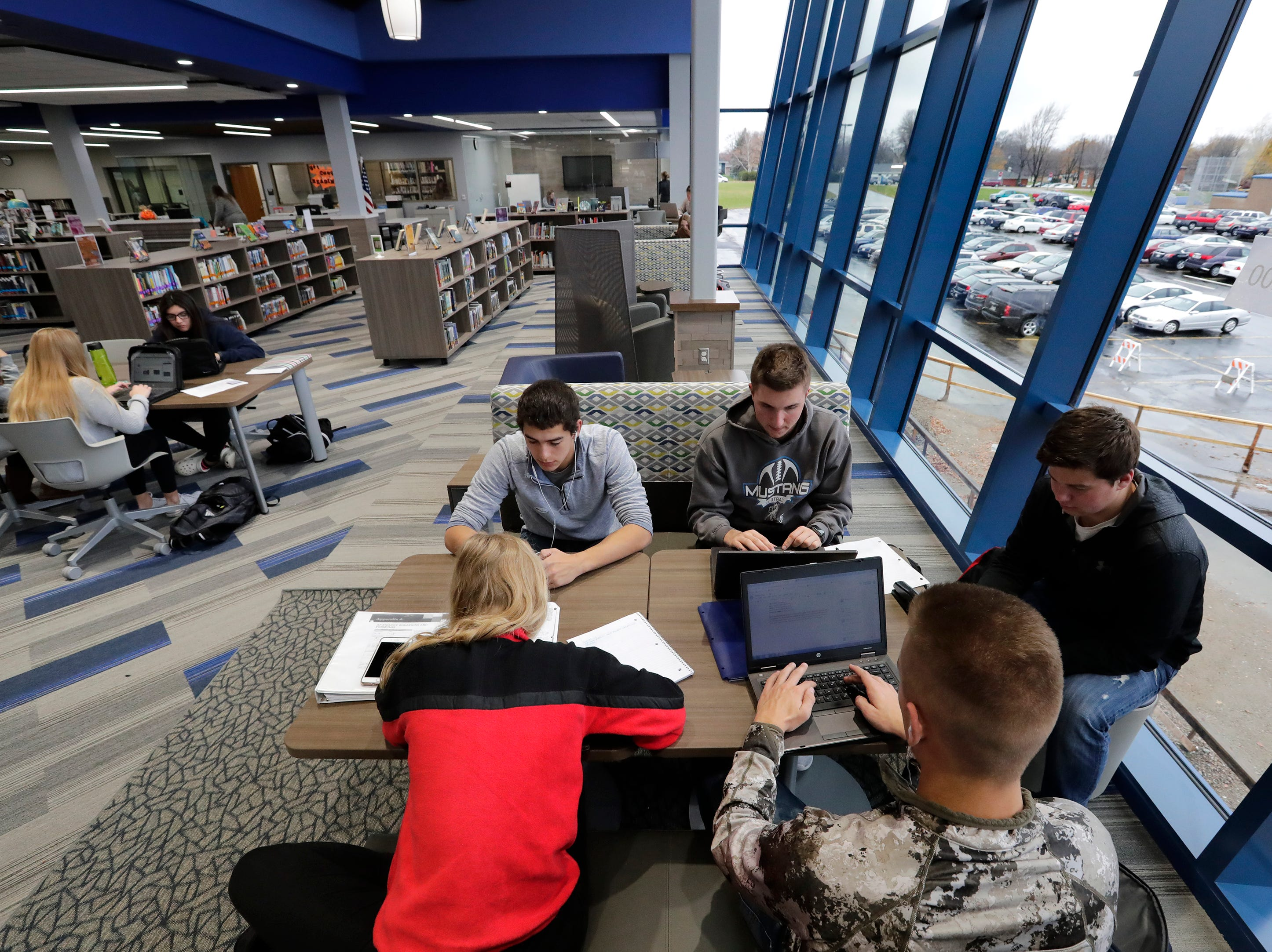 A group of senior students study in the new library at Little Chute High School Tuesday, November 6, 2018, in Little Chute, Wis. 