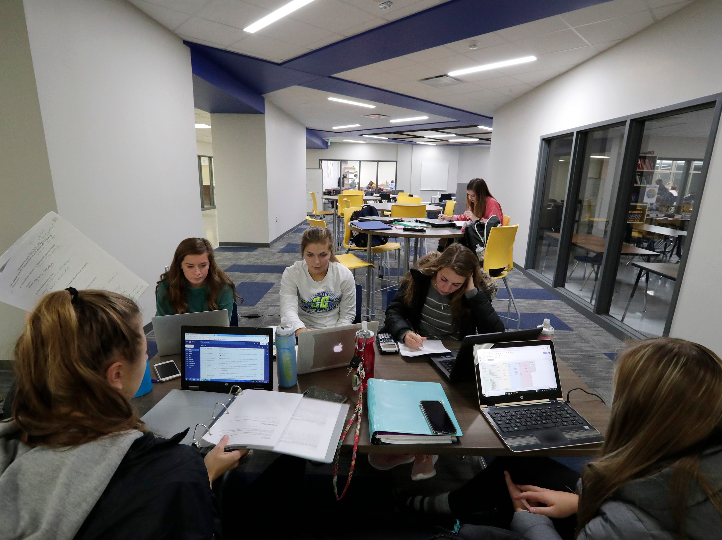 A group of senior students hangout in a collaboration area at Little Chute High School Tuesday, November 6, 2018, in Little Chute, Wis. The areas are for students and teachers to work together in small groups in a comfortable space