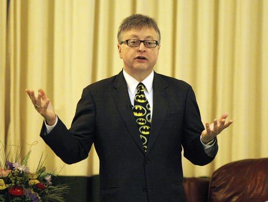 """Batman"" movie producer Michael Uslan, seen speaking at Monmouth University in West Long Branch in 2012."