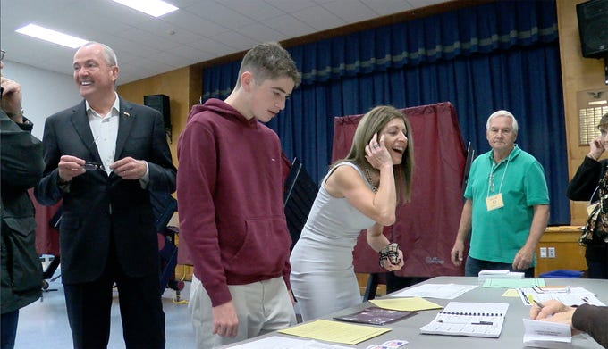 NJ Governor Phil Murphy is joined by his son Sam and wife Tammy as they vote at the Fairview Elementary School in Middletown Tuesday, November 6, 2018.