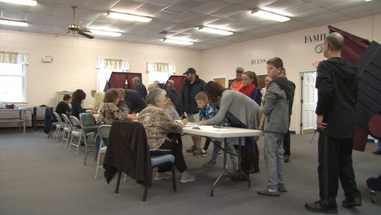 Voters sign in at their polling place in Toms River.