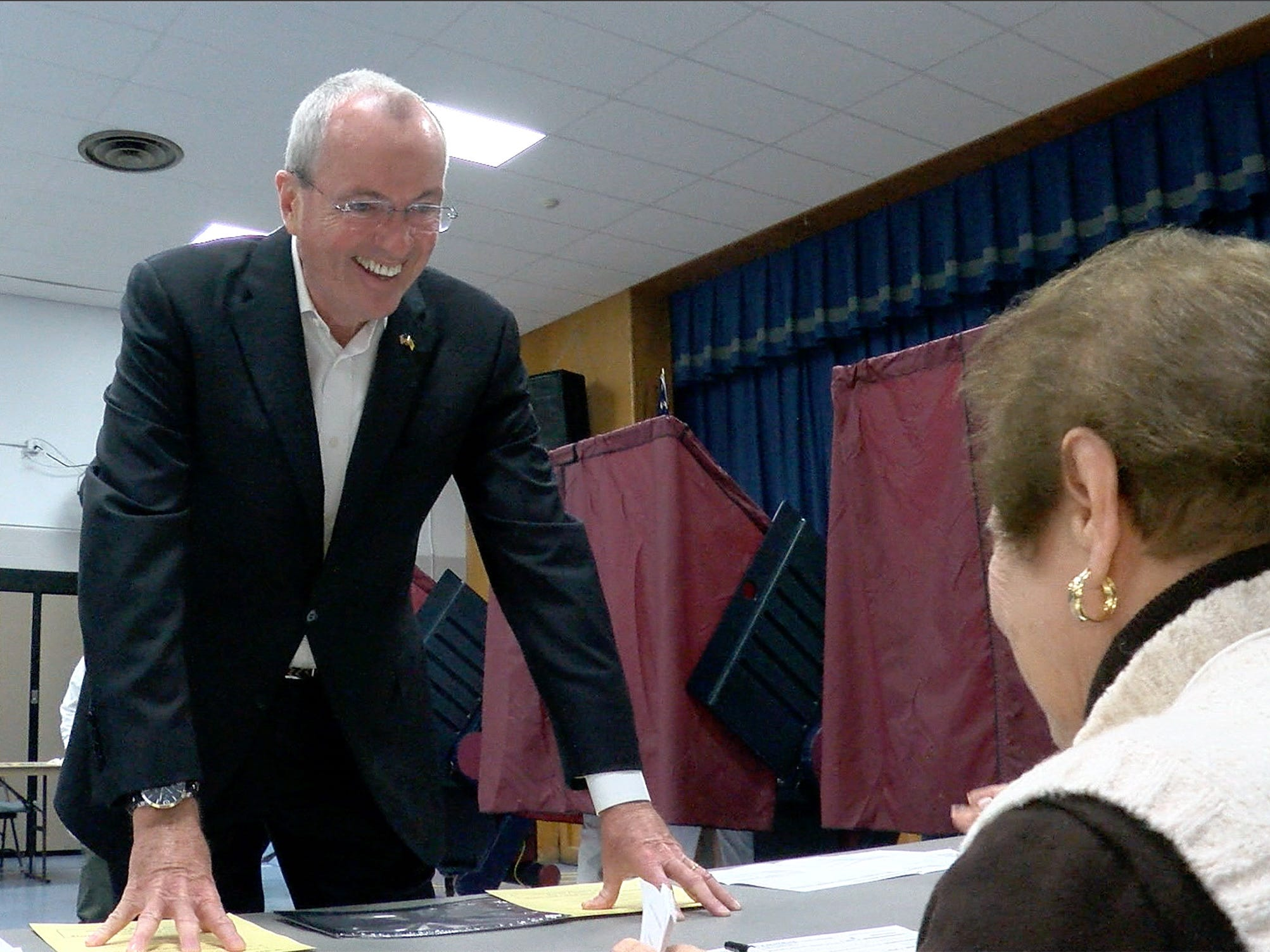NJ Governor Phil Murphy talks with a poll worker as he prepares to vote at the Fairview Elementary School in Middletown Tuesday, November 6, 2018.