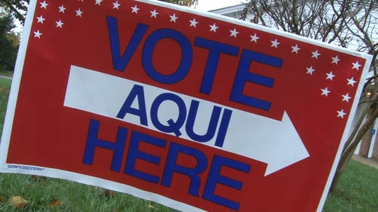A bilingual voting sign outside First United Methodist Church in Toms River